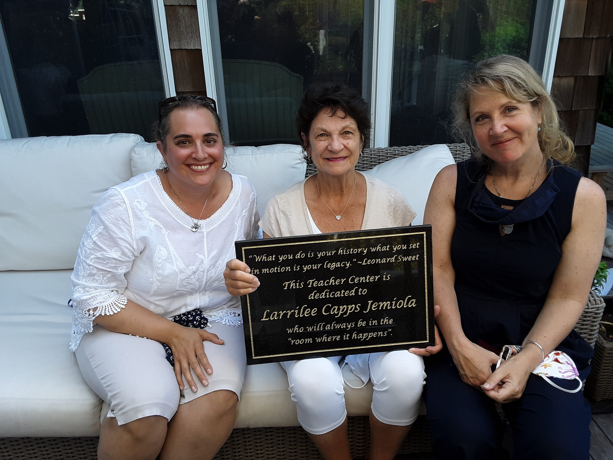 Larrilee Jemiola, an East Hampton resident who is retiring after 51 years of service to the East End educational community, is celebrated at a recent Peconic Teacher Center policy board meeting by new Co-Directors Kim Milton and Kelly Anderson.