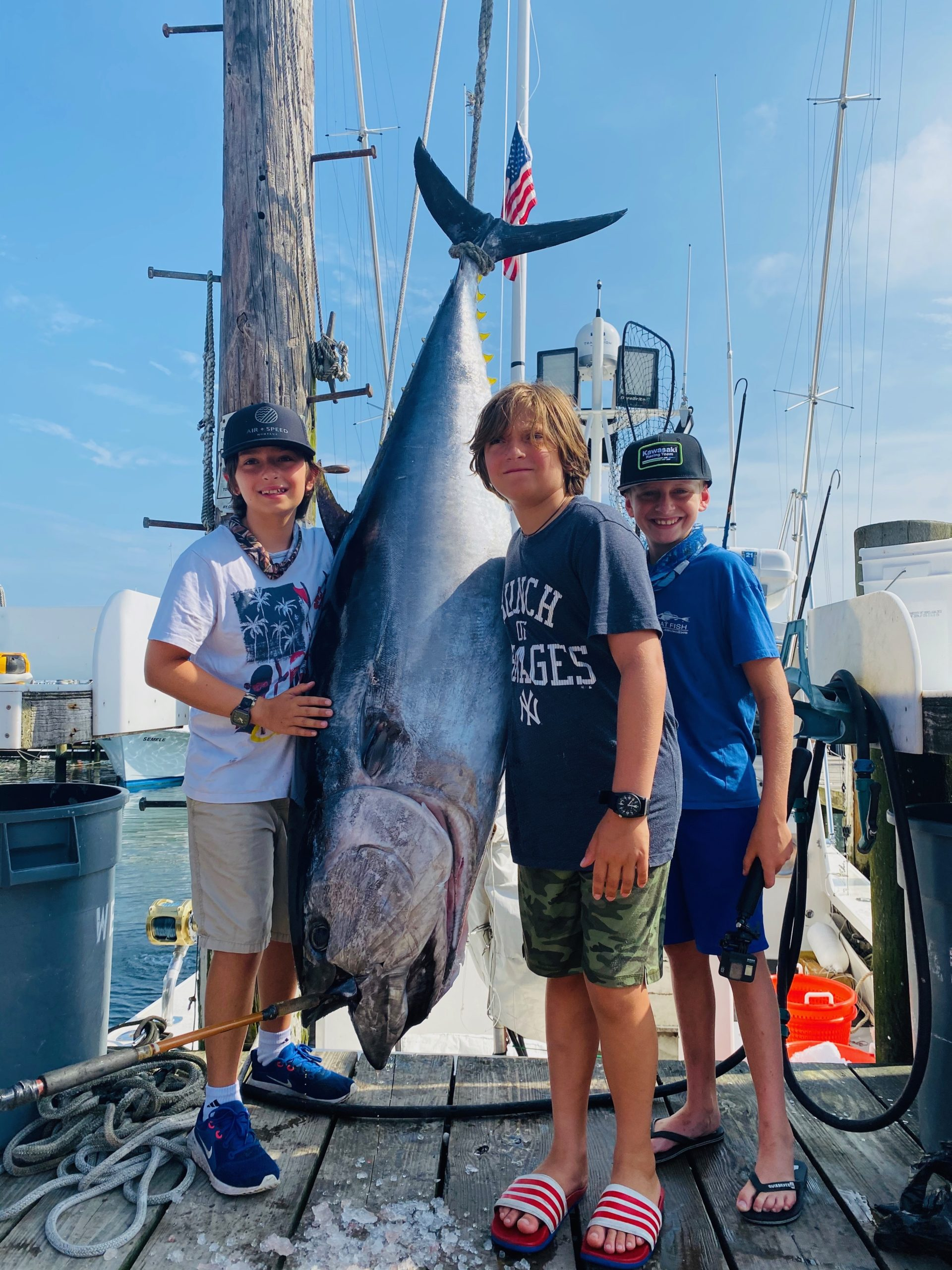 Leo and Massi Mancinelli and Brayden Fromm pose with the 240 pound bluefin tuna they caught while fishing aboard the Flying Dutchman off Montauk last week.