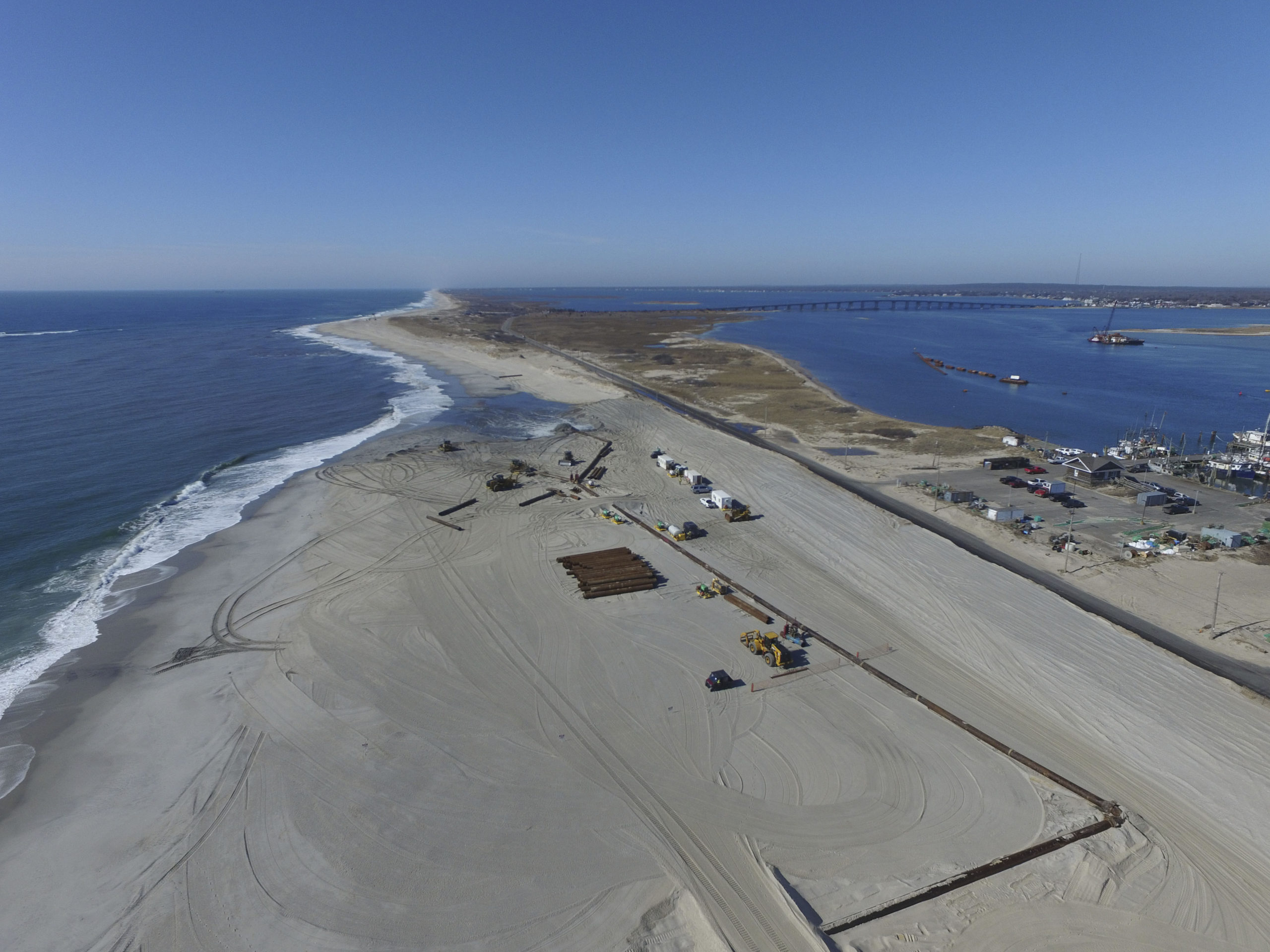 Crews pump hundreds of thousands of cubic yards of sand onto the beach just west of theShinnecock Inlet in Hampton Bays in February.  PRESS FILE