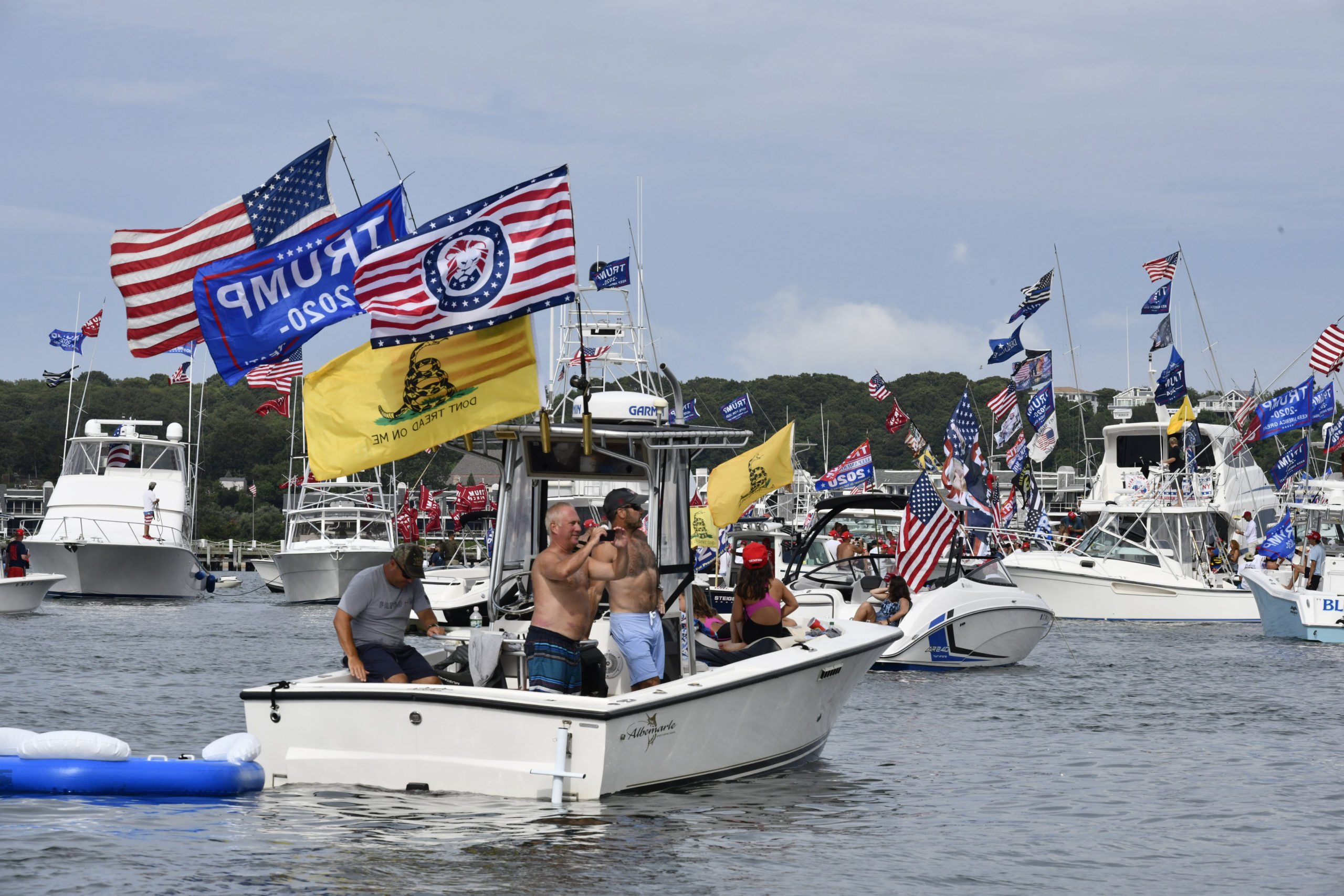 Supporters of President Donald Trump gather in Fort Pond Bay on Friday afternoon.