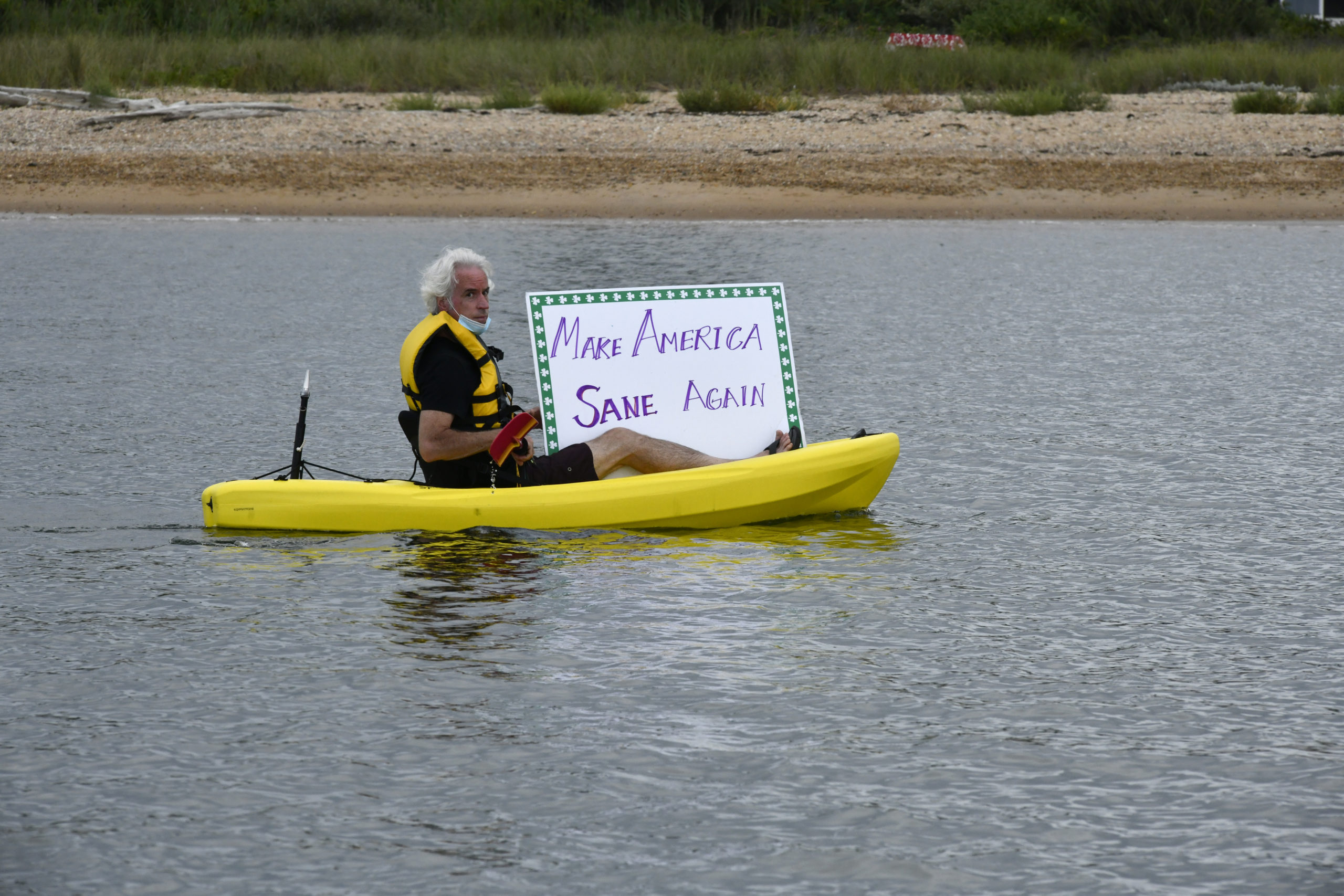 Kayaker Thomas Byrne shows his support for presidential candidate Joe Biden at