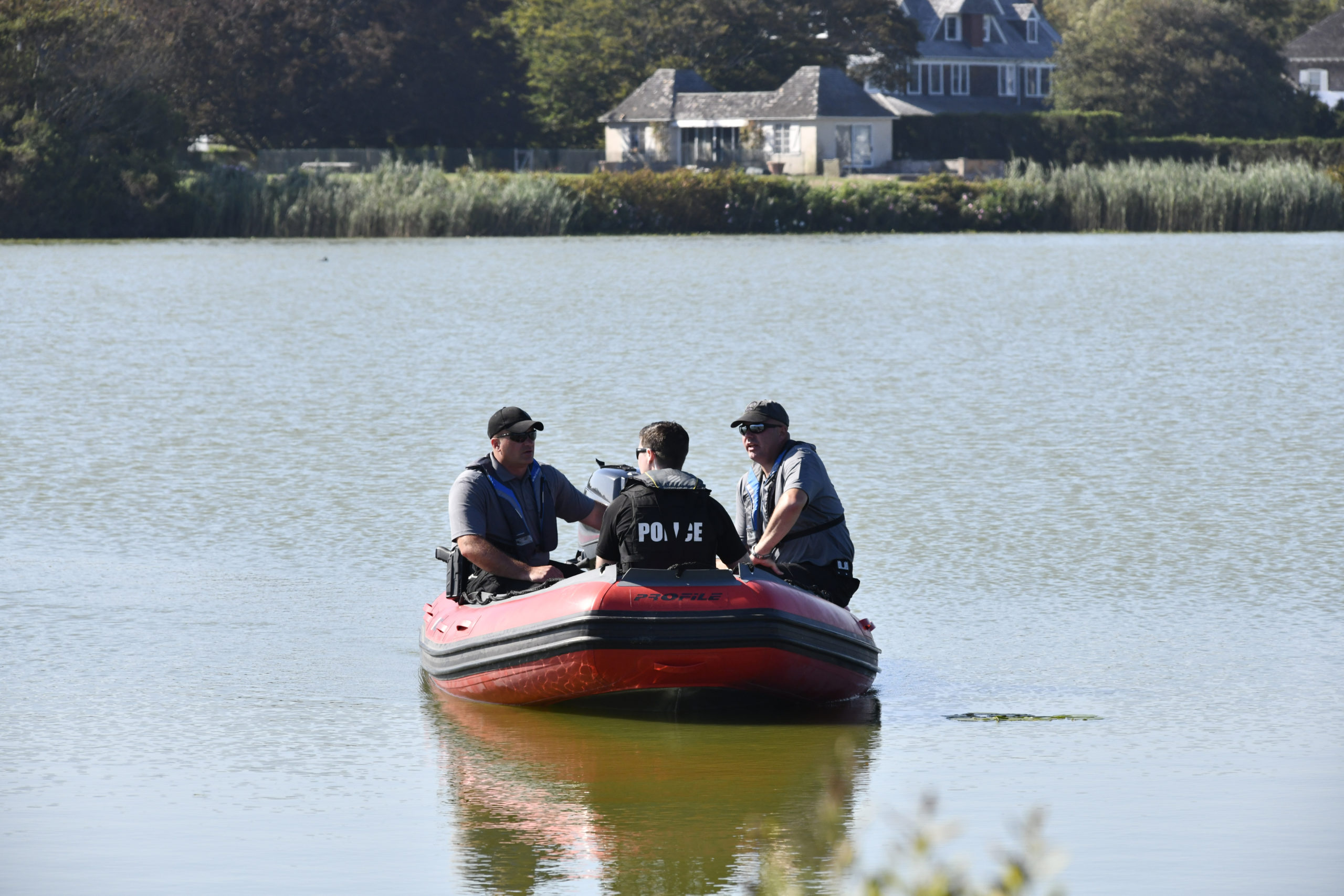Police on Lake Agawam on Saturday afternoon in advance of Donald Trump's visit for a fundraising event.  DANA SHAW