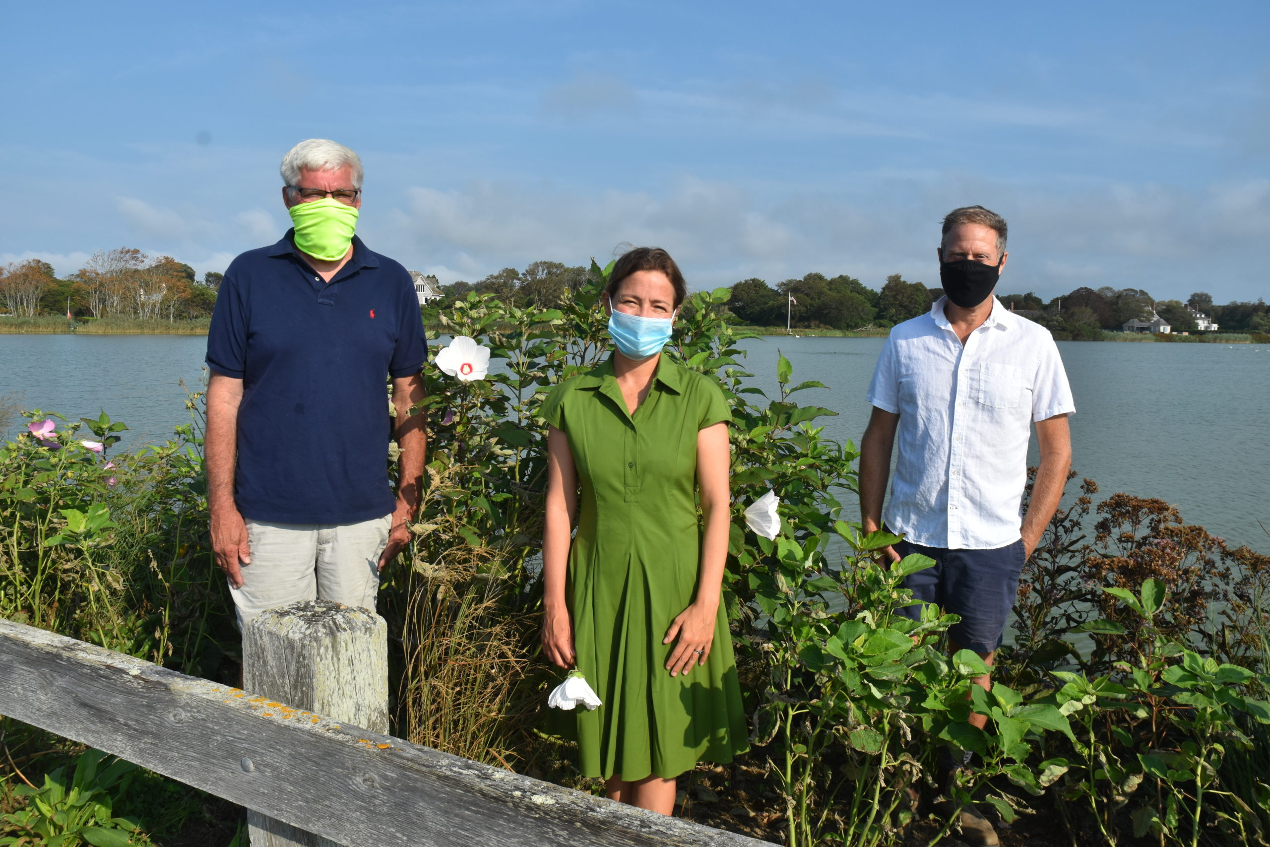 Southampton Town Trustee Bill Pell, Meghan Magyar, a member of the board of the Lake Agawam Conservancy, and horticulturalist Tony Piazza at a bioswale that was planted this year to help filter pollutants from entering Lake Agawam. STEPHEN J, KOTZ