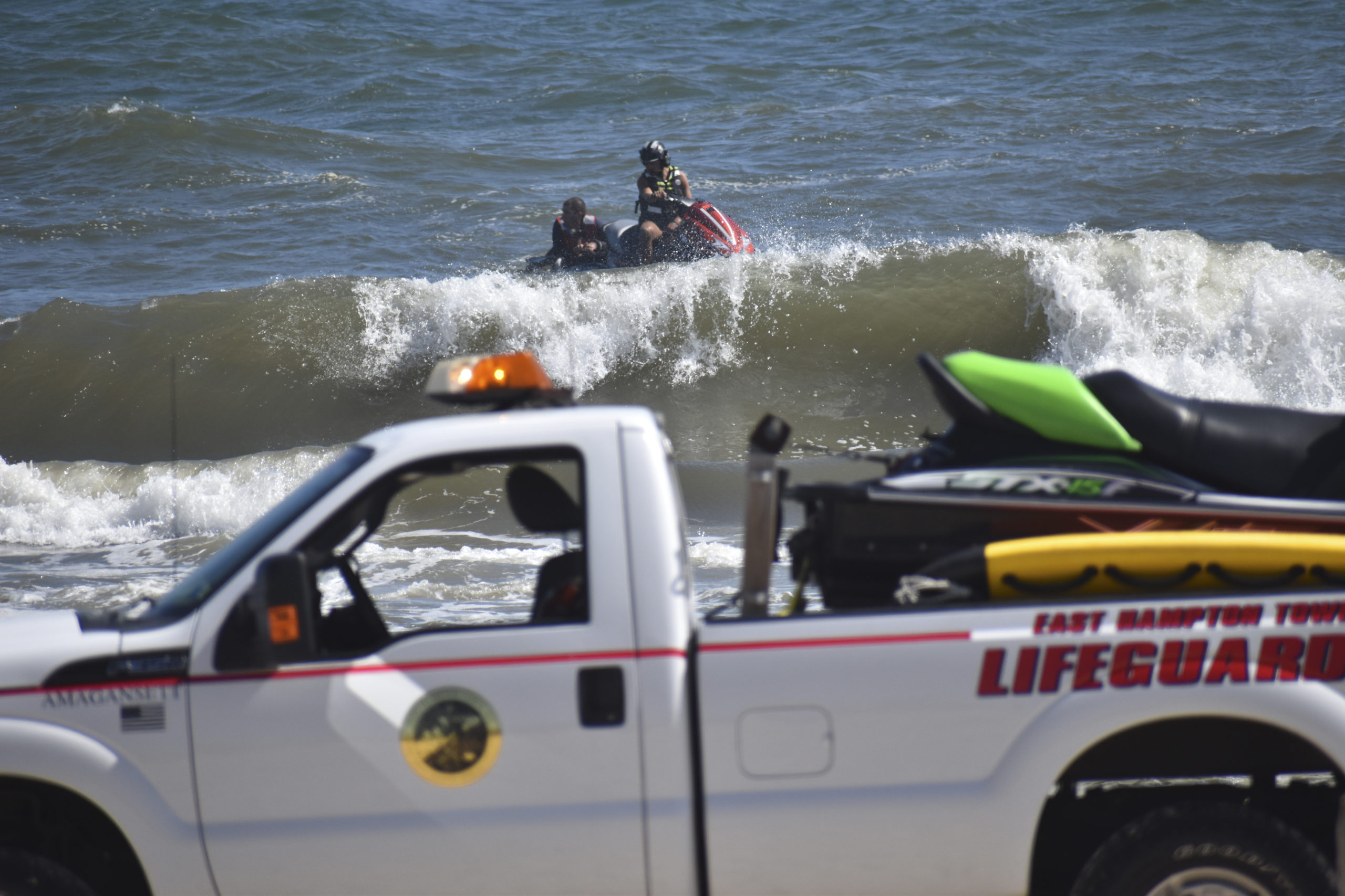 Members of the East Hampton Volunteer Ocean Rescue, police and the U.S. Coast Guard continue to search for a missing swimmer on the beach between Napeague State Park and Hither Hills Tuesday afternoon.   GAVIN MENU