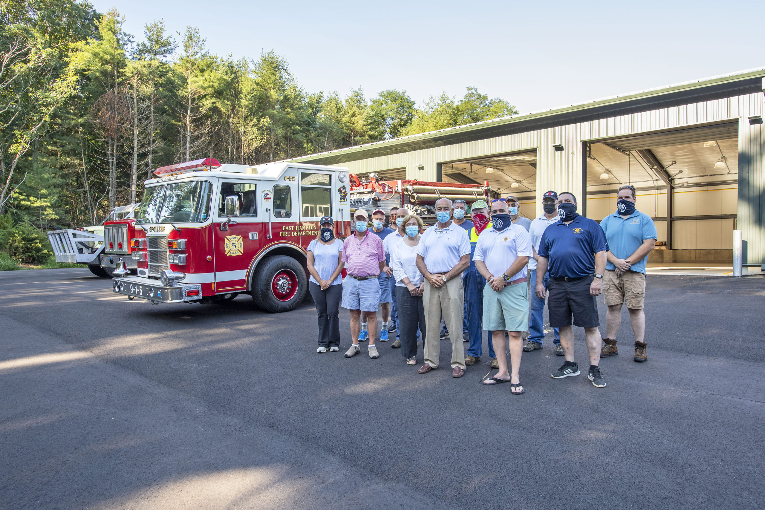 East Hampton Fire Department Chief Gerard Turza, Jr., his Assistant Chief Duane Forrester and EHFD officers welcomed members of the East Hampton Village Board as trucks 9-1-5, 9-1-10 and 9-1-13 were moved into the brand new EHFD Substation on Old Northwest Road on Saturday.  MICHAEL HELLER