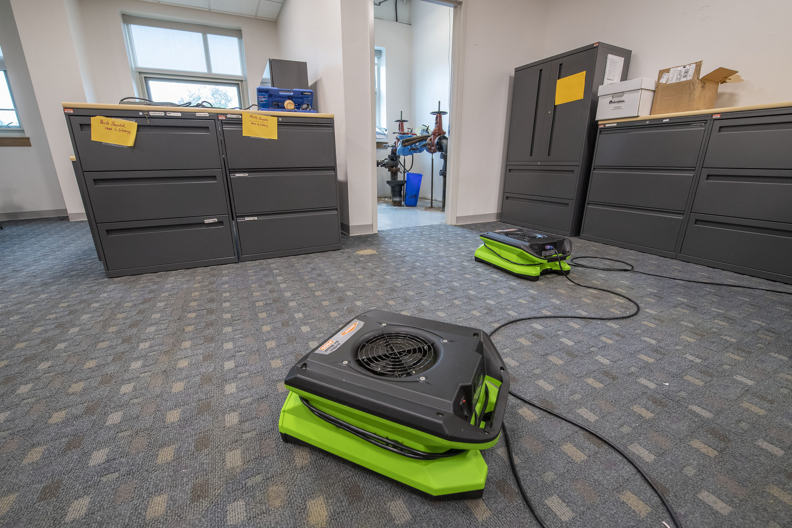 Carpeting and drywall in the East Hampton School District's administrative offices will have to be replaced after a flood caused by a broken water pipe over the weekend. MICHAEL HELLER