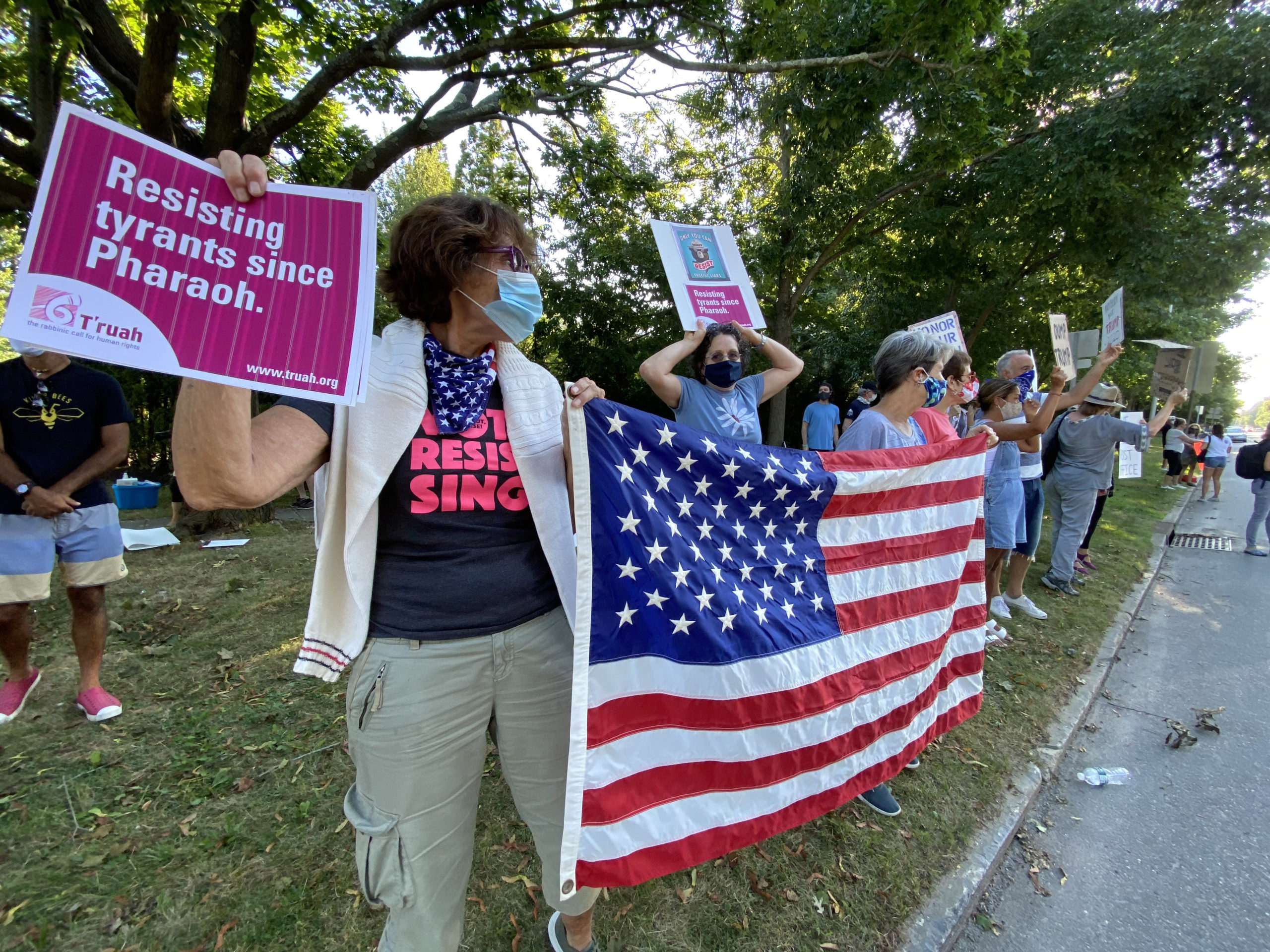 A protest was held in Southampton Village on Saturday afternoon during President Donald Trump's visit for a fundraising event. DANA SHAW