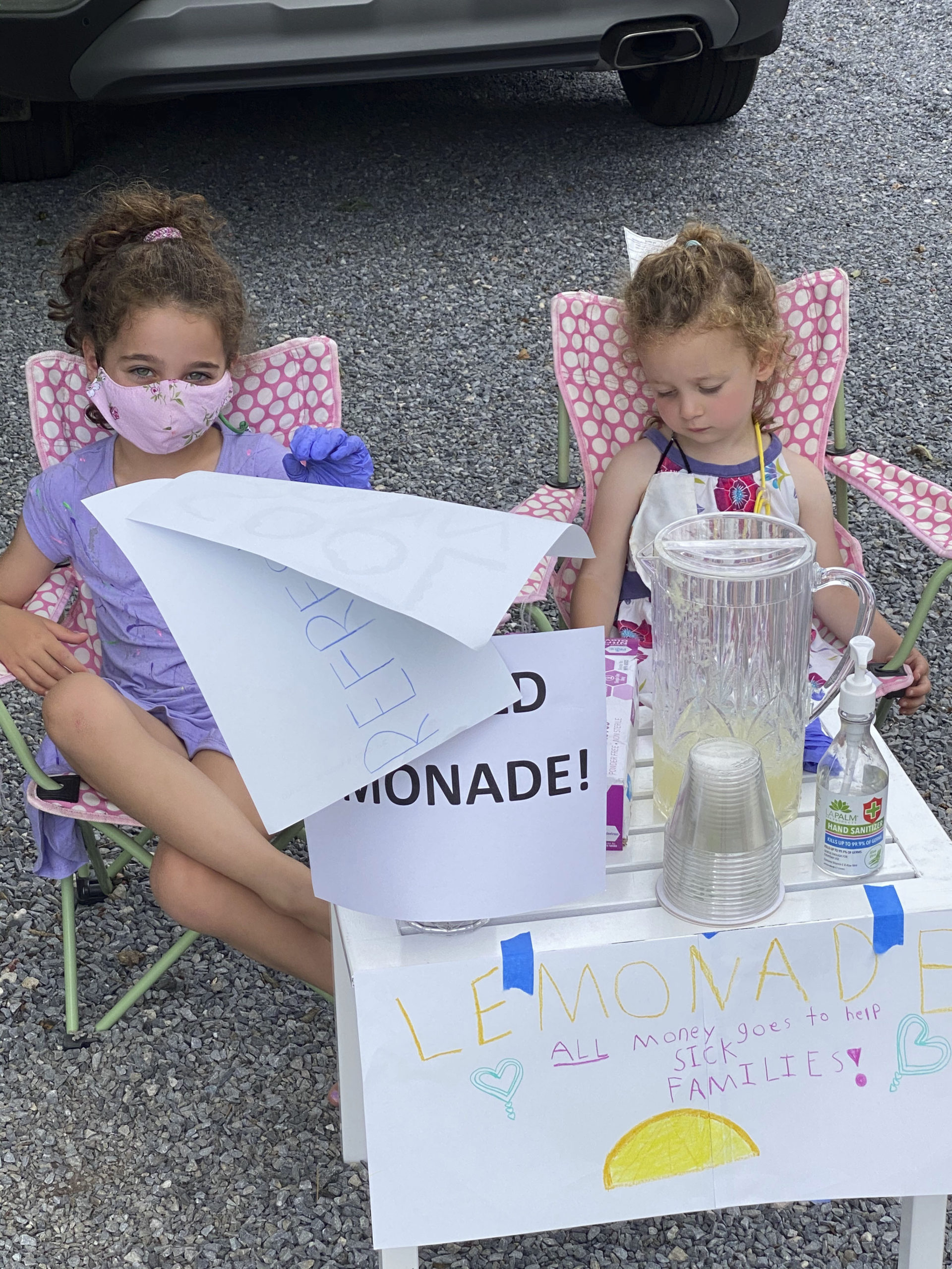 Dylan Ehrlich, 6, and Logan Ehrlich, 2, residing in East Hampton Village for the summer ran a lemonade stand on Friday and Saturday and raised $94 which they are donating to the local hospital.  COURTESY STEPHEN FRISHBERG
