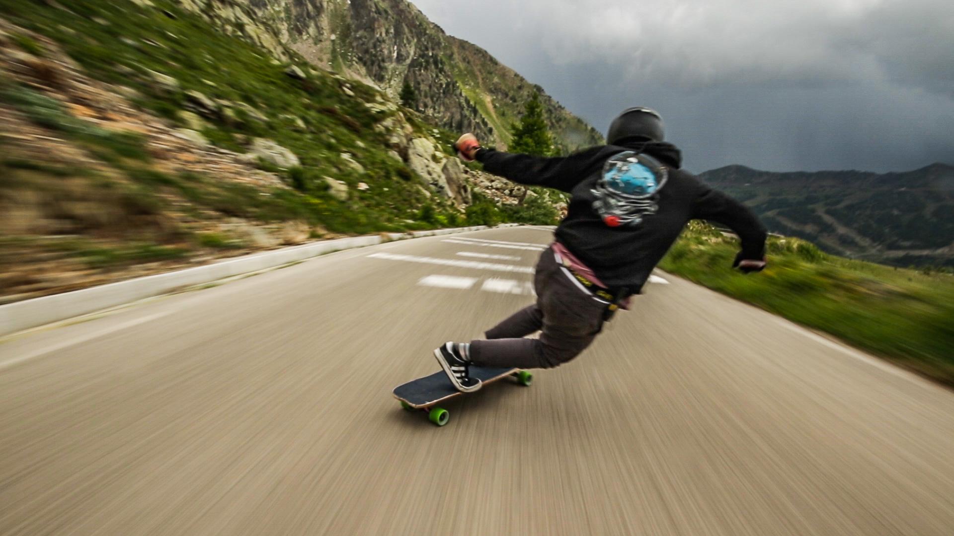 """Raw Run: The Cliffs of France"" follows Josh Neuman longboarding down a narrow highway in France."