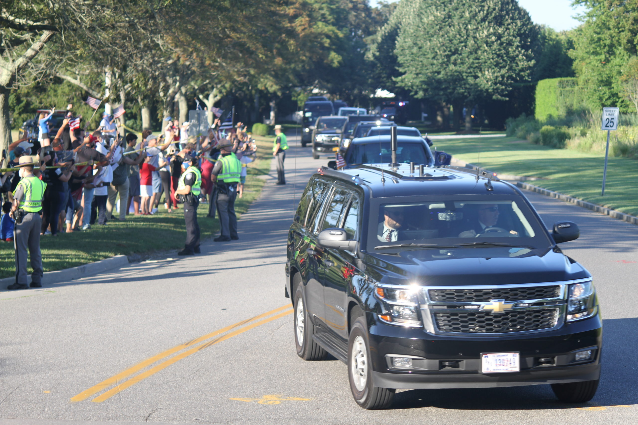 The president's motorcade and police escorts roll down Wickapogue Road in Southampton Village.