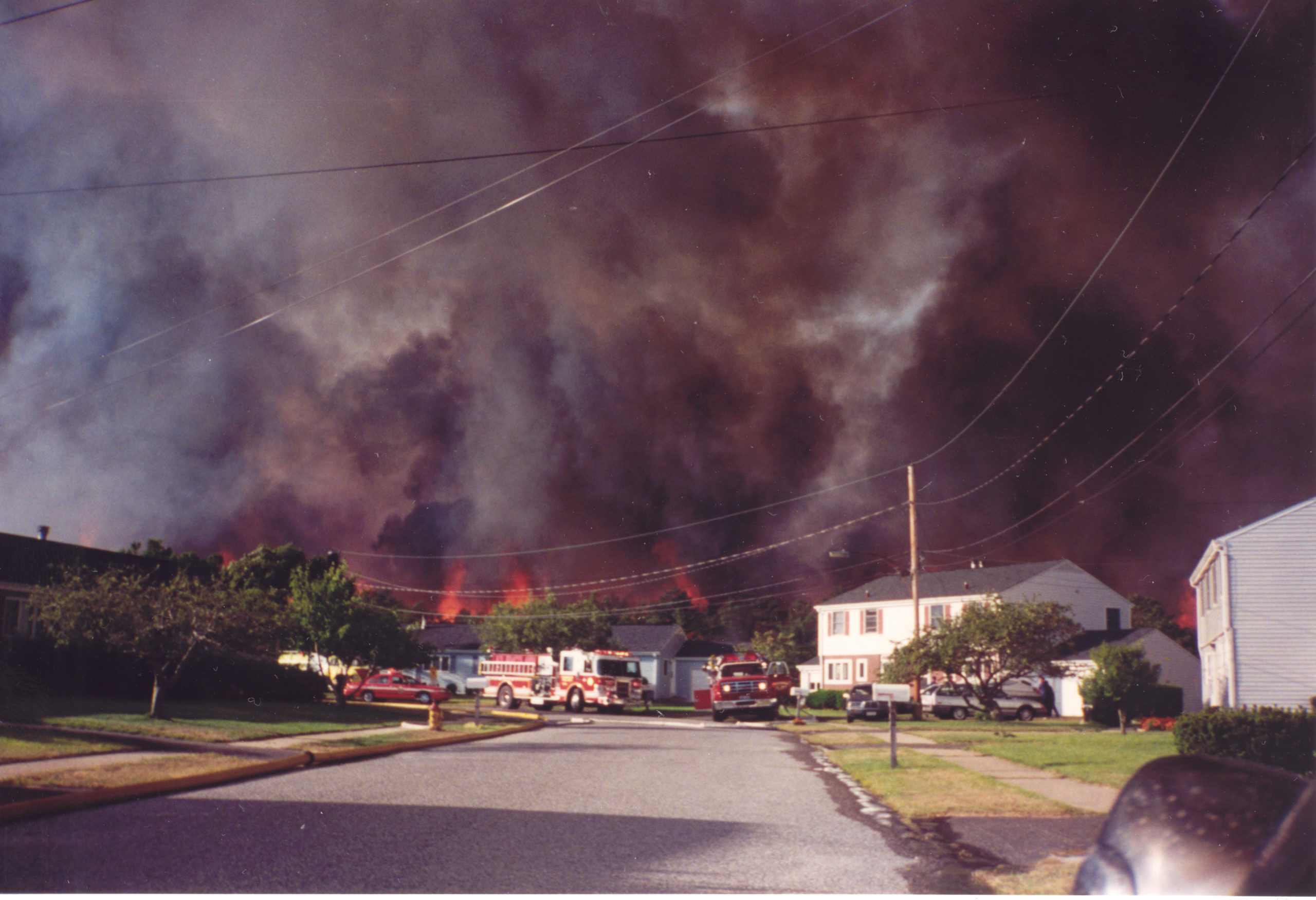 Fire companies from all over Long Island came to fight the wildfires in Westhampton in August of 1995.  COURTESY JIM BAKER.