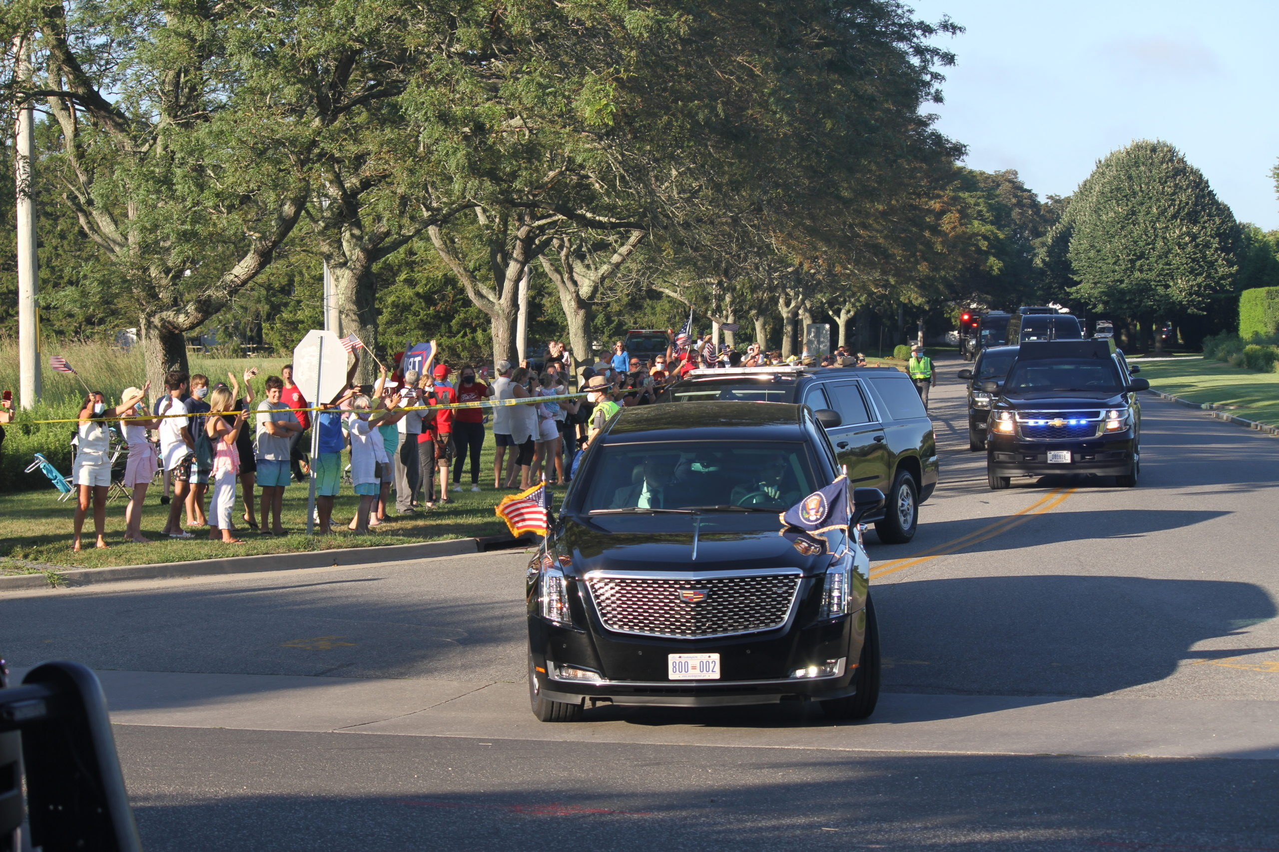 Small groups of protestors and supporters gathered along the preident's motorcade route through Southampton Village on Saturday evening.