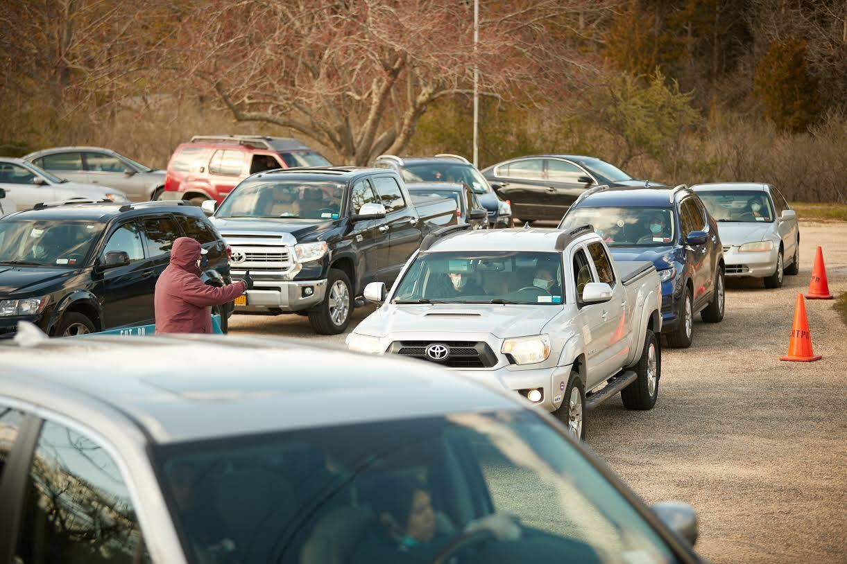 Cars filled the lot at the Springs Community Presbyterian Church with clients for the food pantry this spring.  JOHN MADERE PHOTOGRAPHY