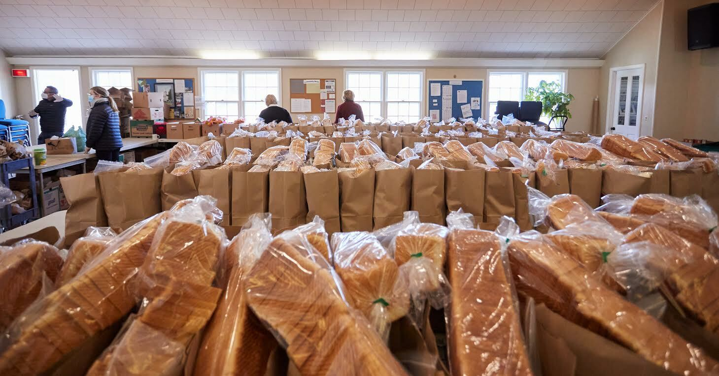 Preparing for visitors at the Springs Food Pantry. JOHN MADERE PHOTOGRAPHY