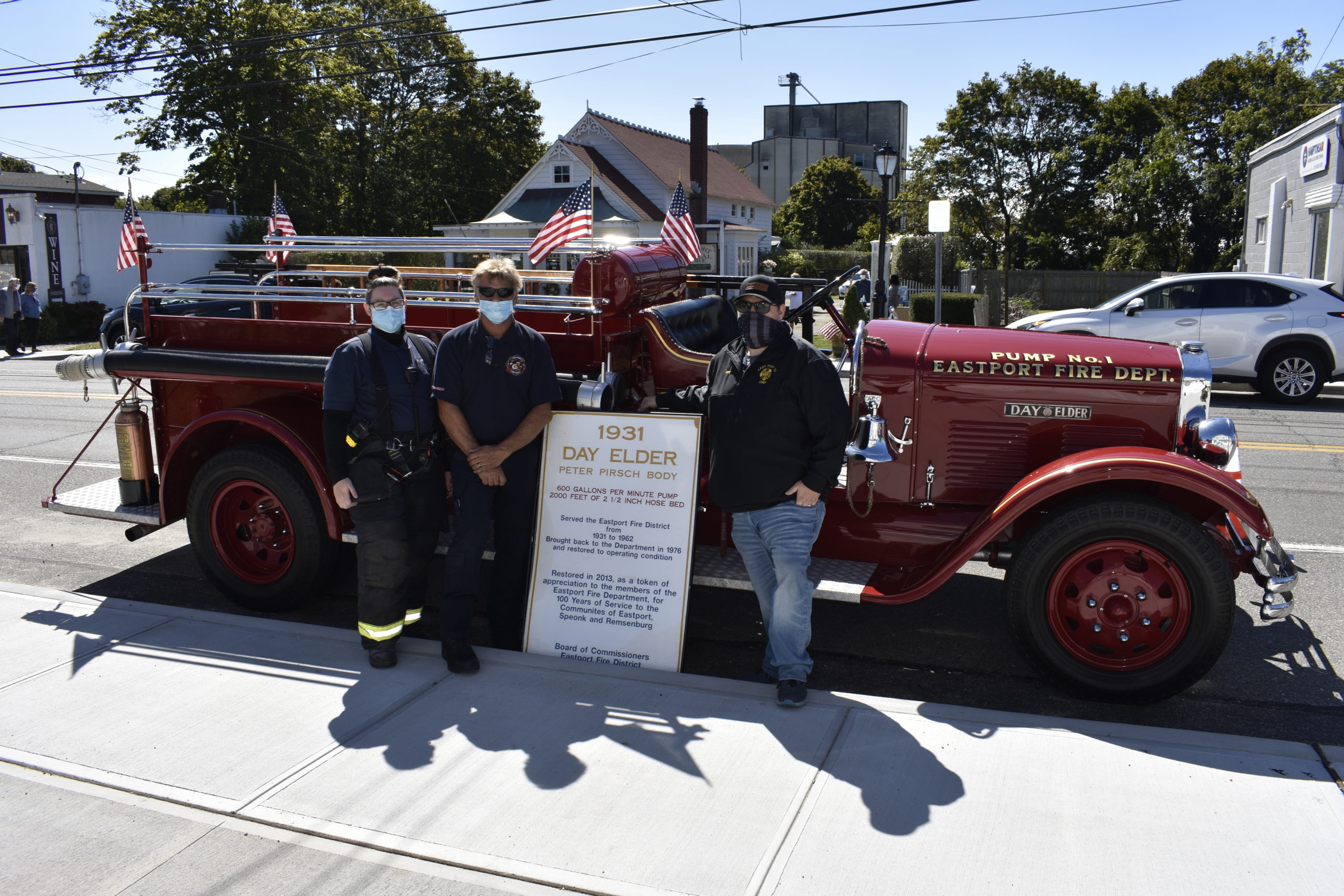 2nd Lt. Melissa Rankin, firefighter Roy Yeagar and Chief Mike Tortorice of the Eastport Fire Department showed off a vintage 1931 Day Elder firetruck.