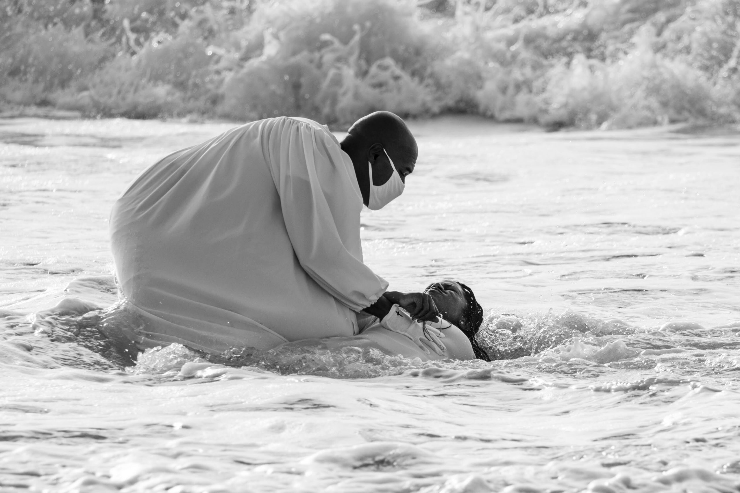 The Rev. Tisha Williams and her husband, Deacon Lawrence Williams, baptize Shakeva Brown and Delana Miller on Saturday in Bridgehampton. Both women have waited six months to be baptized as a result of the COVID-19 virus pandemic.