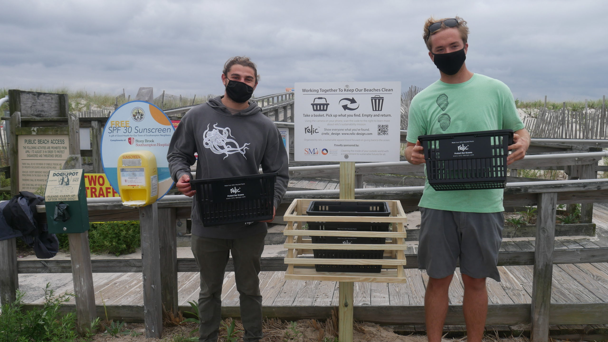 Aiden Kravitz and John Pike from Relic at the unveiling of the beach basket program at Pike's Beach in Westhampton Beach.