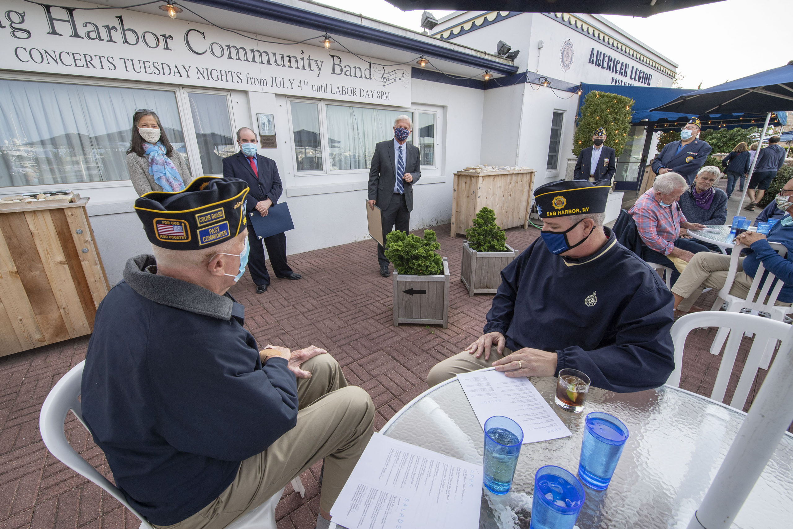 Robert Browngardt, at left, is honored by New York State Assemblyman Fred Thiele for 50 years of Service to The American Legion during a ceremony on the patio in front of the legion's Chelberg & Battle Post 388 on Tuesday evening.       MICHAEL HELLER