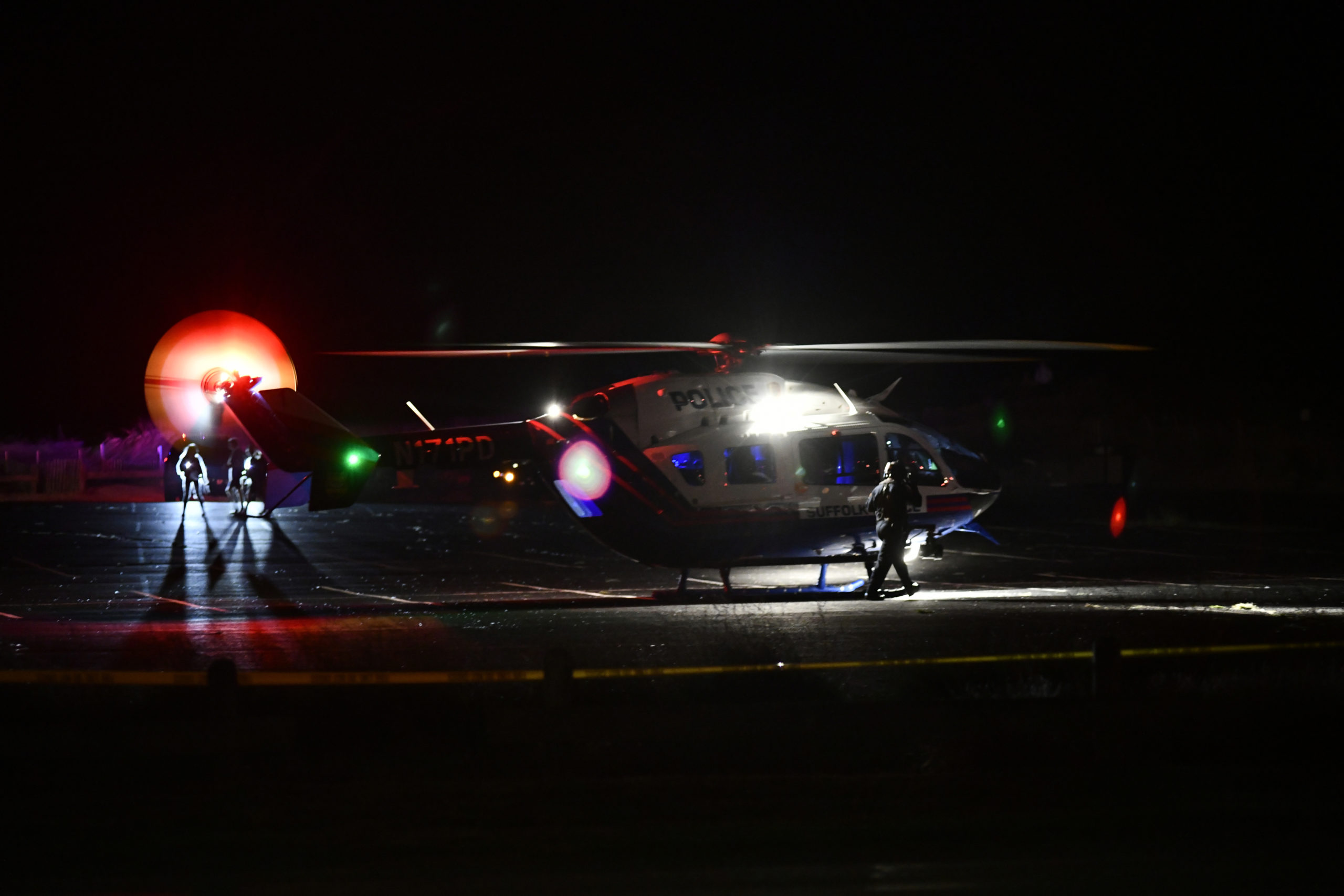 Two medevac helicopters landed at the Ponquogue Beach parking lot in Hampton Bays after an accident on Dune Road on Friday night. Both drivers were airlifted to Stony Brook University Hosptial.  DANA SHAW