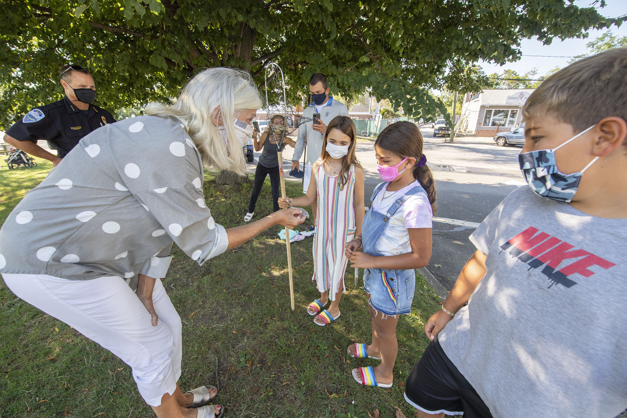 As Sag Harbor Village Police Chief Austin McGuire, brother Kyle, friend Lila Wiesenthal and family look on, Elle Maslin is presented with a