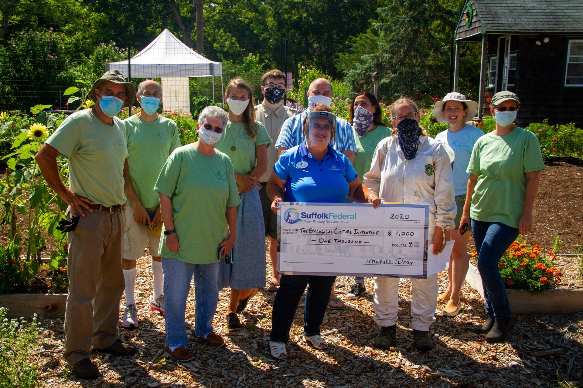 Staff and volunteers of the Ecological Culture Initiative with Debra Castro, Suffolk Federal Riverhead Branch Manager.
