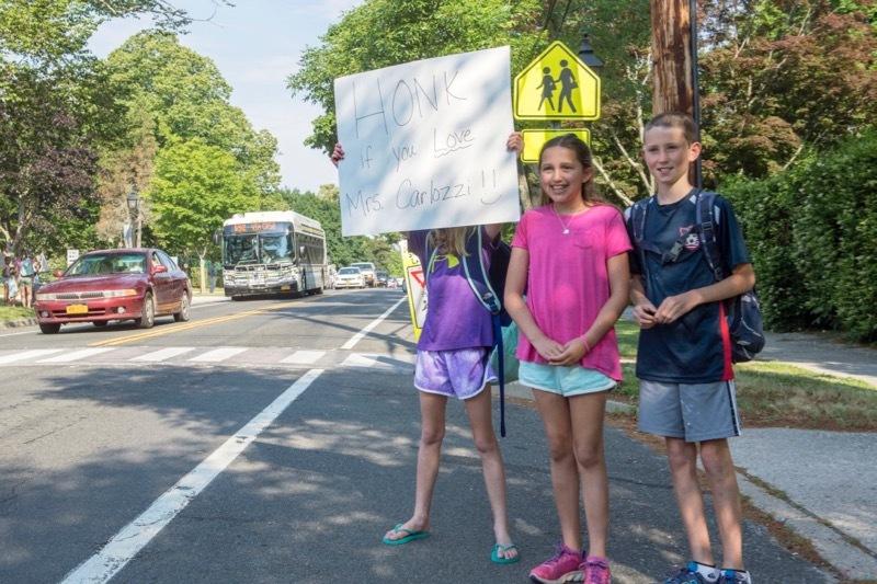 Children celebrating greeter and school monitor Cathy Carlozzi.