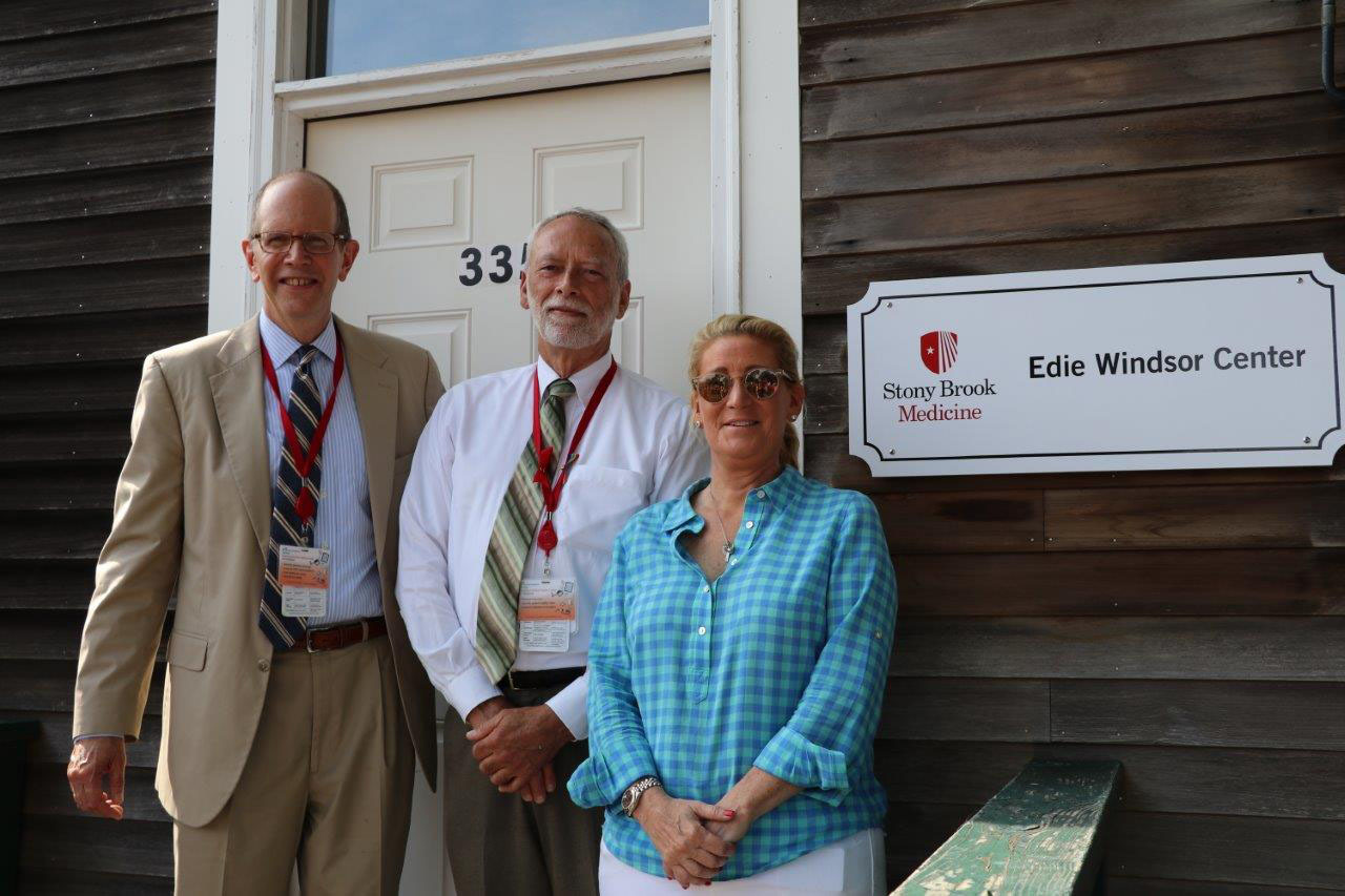 Robert S. Chaloner, Chief Administrative Officer, Stony Brook Southampton Hospital; Michael Collins, Site Administrator; and Judith Kasen-Windsor unveiled signage for the Edie Windsor Center at 335-B Meeting House Lane in Southampton, which was formally the David E. Rogers, MD Center. The name change reflects plans for the Edie Windsor Center to serve as a dynamic conduit to an expanding array of initiatives as part of the Hospital's vision of reimagining the healthcare landscape on the East End.     COURTESY STONY BROOK SOUTHAMPTON HOSPITAL