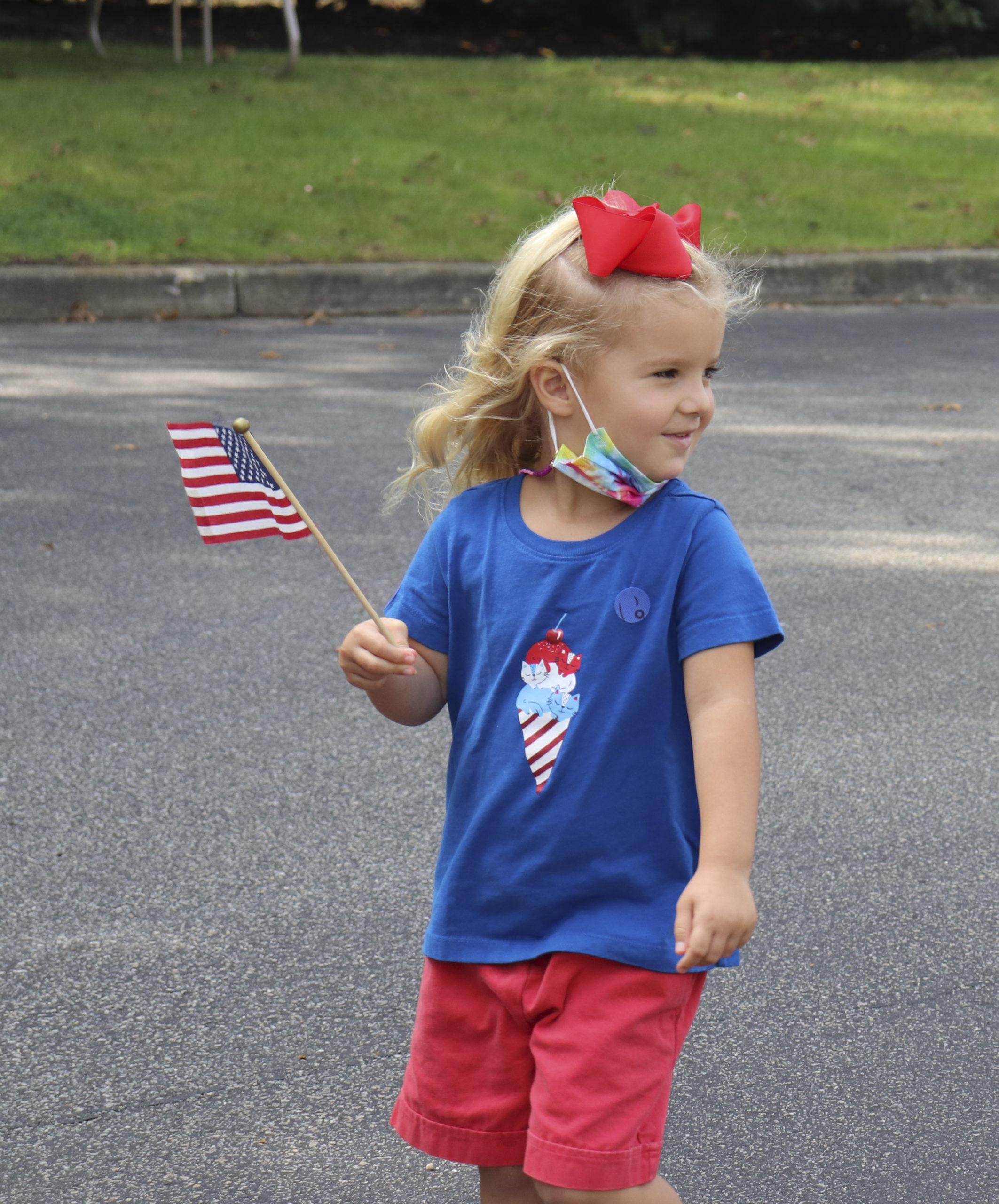 Pre-K student, Julia Cammarata marches proudly in Raynor Country Day School's parade to honor Patriot Day on Friday, September 11.    COURTESY RAYNOR COUNTRY DAY SCHOOL