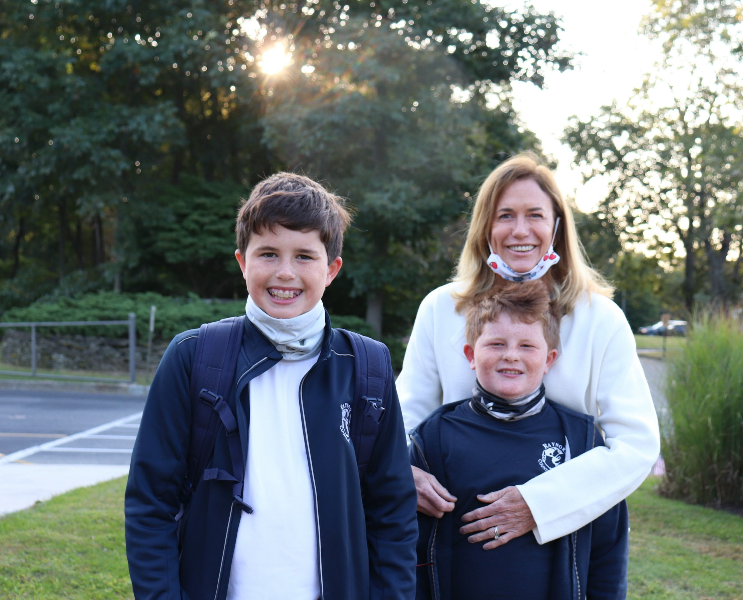 Raynor Country Day School parent, Michelle Kelly poses with her boys, fellow RCDS students, Sean and Kevin Kelly, before the school's