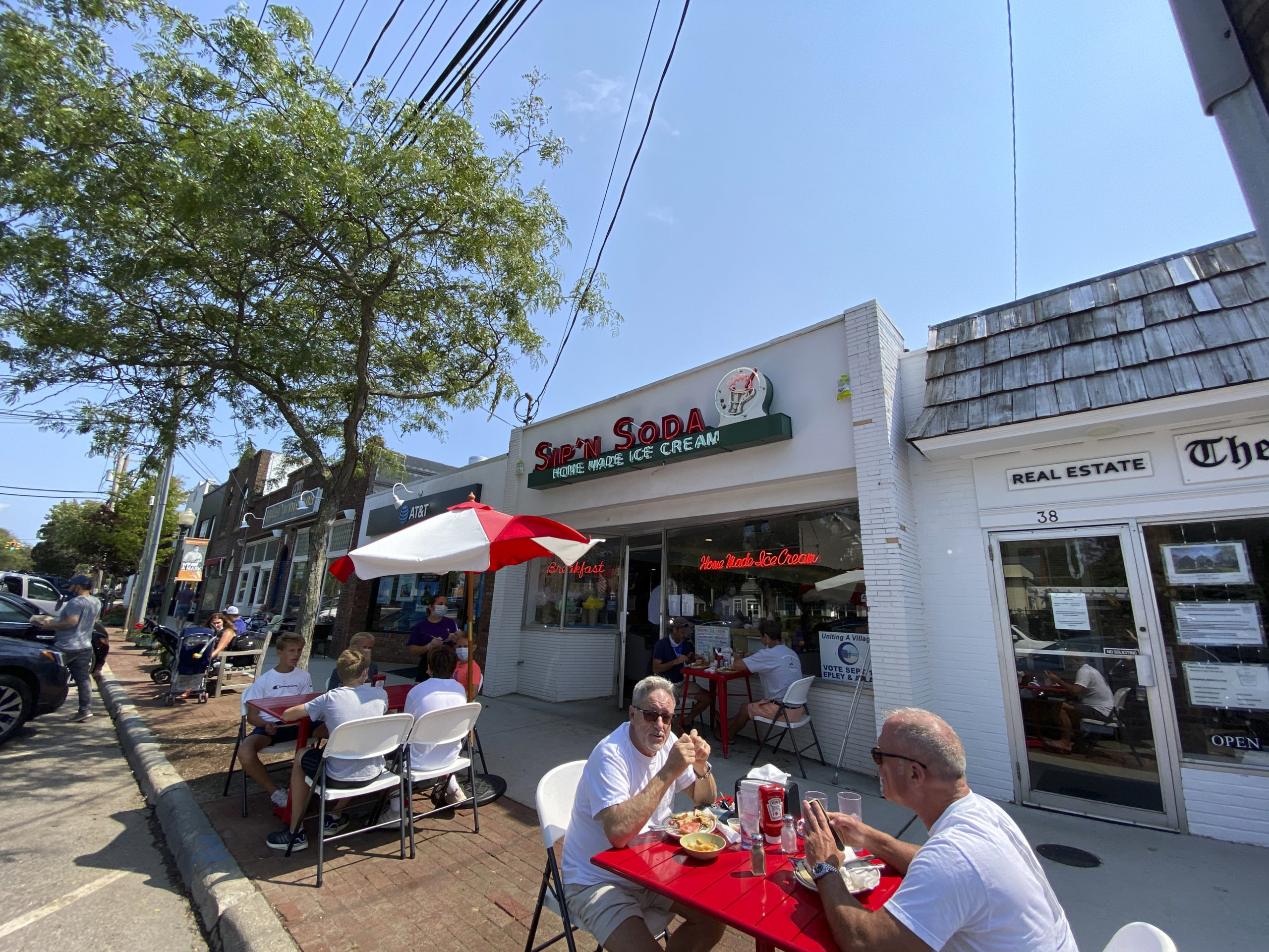 Southampton Village staple Sip N' Soda added tables for outdoor dining to accommodate guests. DANA SHAW