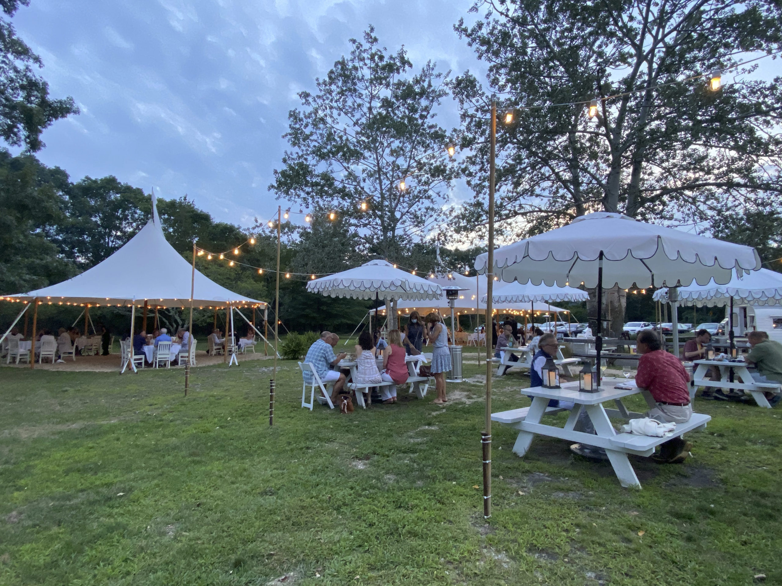 The Stone Creek Inn in Quogue expanded its outdoor dining space to accommodate guest during the summer adding tents, lights and a fire pit.     DANA SHAW