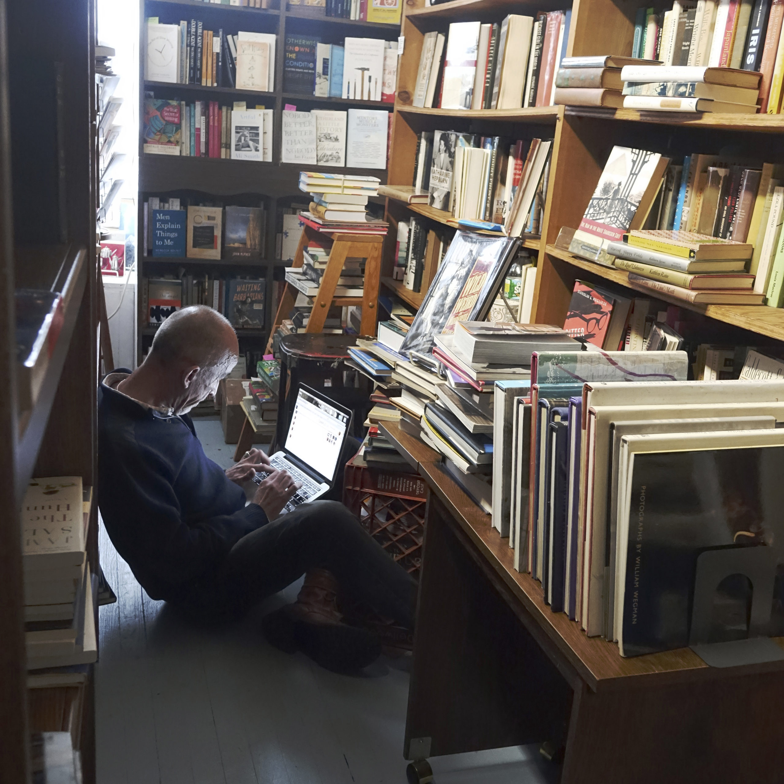 Mark Doty finds a quiet place to work in the stacks at Canio's.      KATHRYN SZOKA