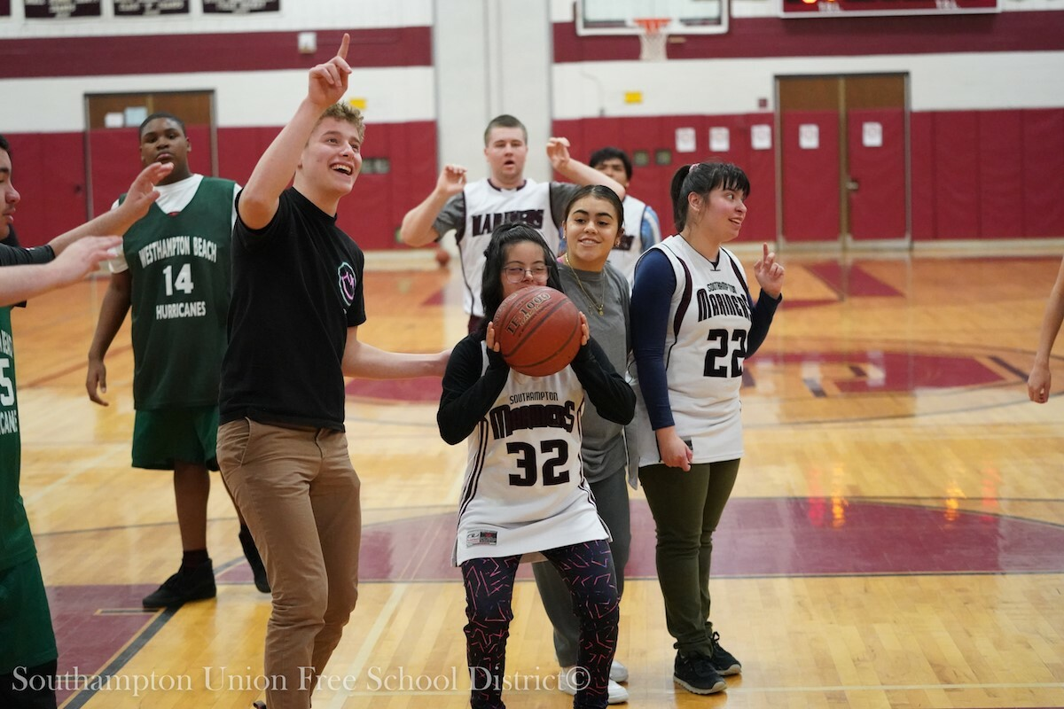 Southampton High School has been recognized by Special Olympics International for its various inclusive sporting programs, including its unified basketball program. Pictured are unified basketball players during a game held last school year. COURTESY SOUTHAMPTON SCHOOL DISTRICT