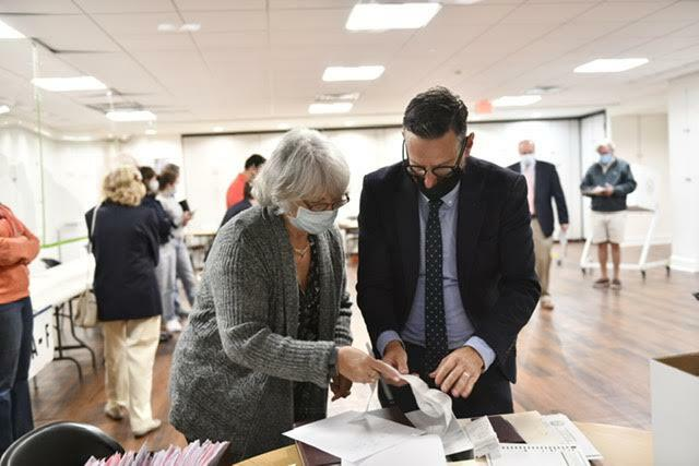 Diane Fisher, Election Inspector Chairperson and Southampton Village Administrator Russell Kratoville tabulate the machine count. DANA SHAW