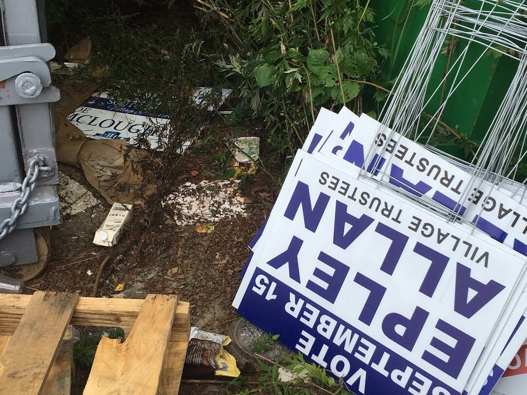 Confiscated political signs piled up at the Southampton Village Department of Public Works. KITTY MERRILL