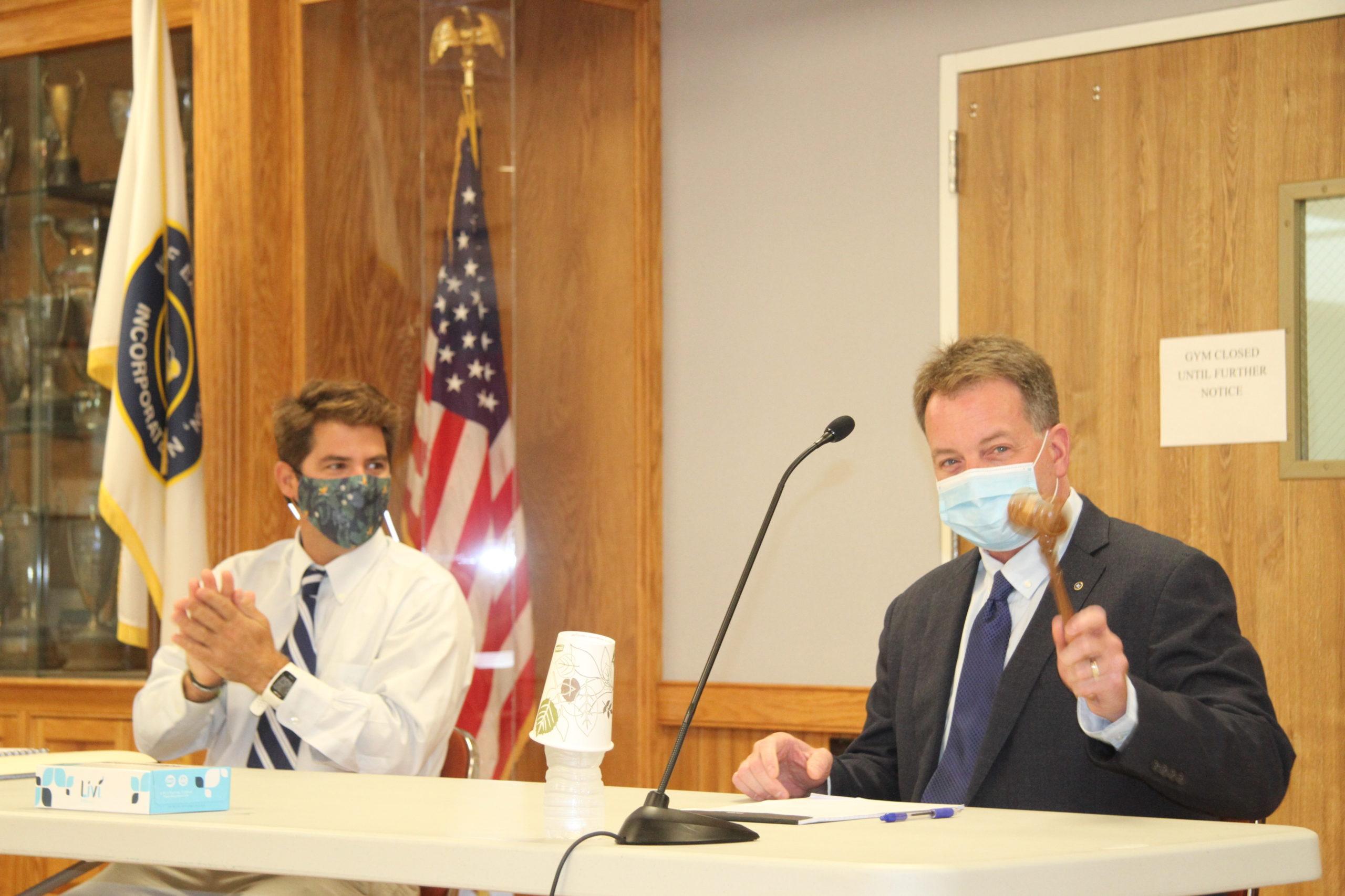 Mayor Jerry Larsen and Trustee Chris Minardi.