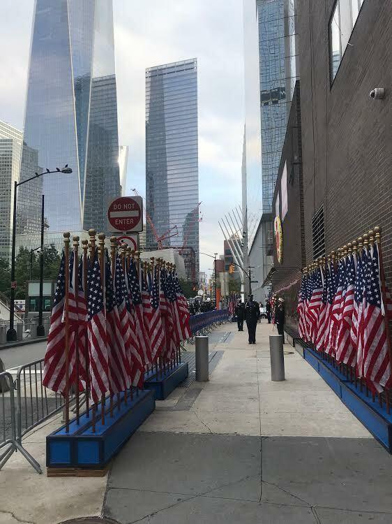 Flags border the wall alongside the firehouse across from Ground Zero.  COURTESY JAMES BURKE