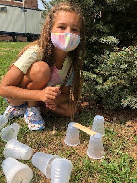 Bridgehampton School third grader Savanna Lillie built a tower with plastic cups.