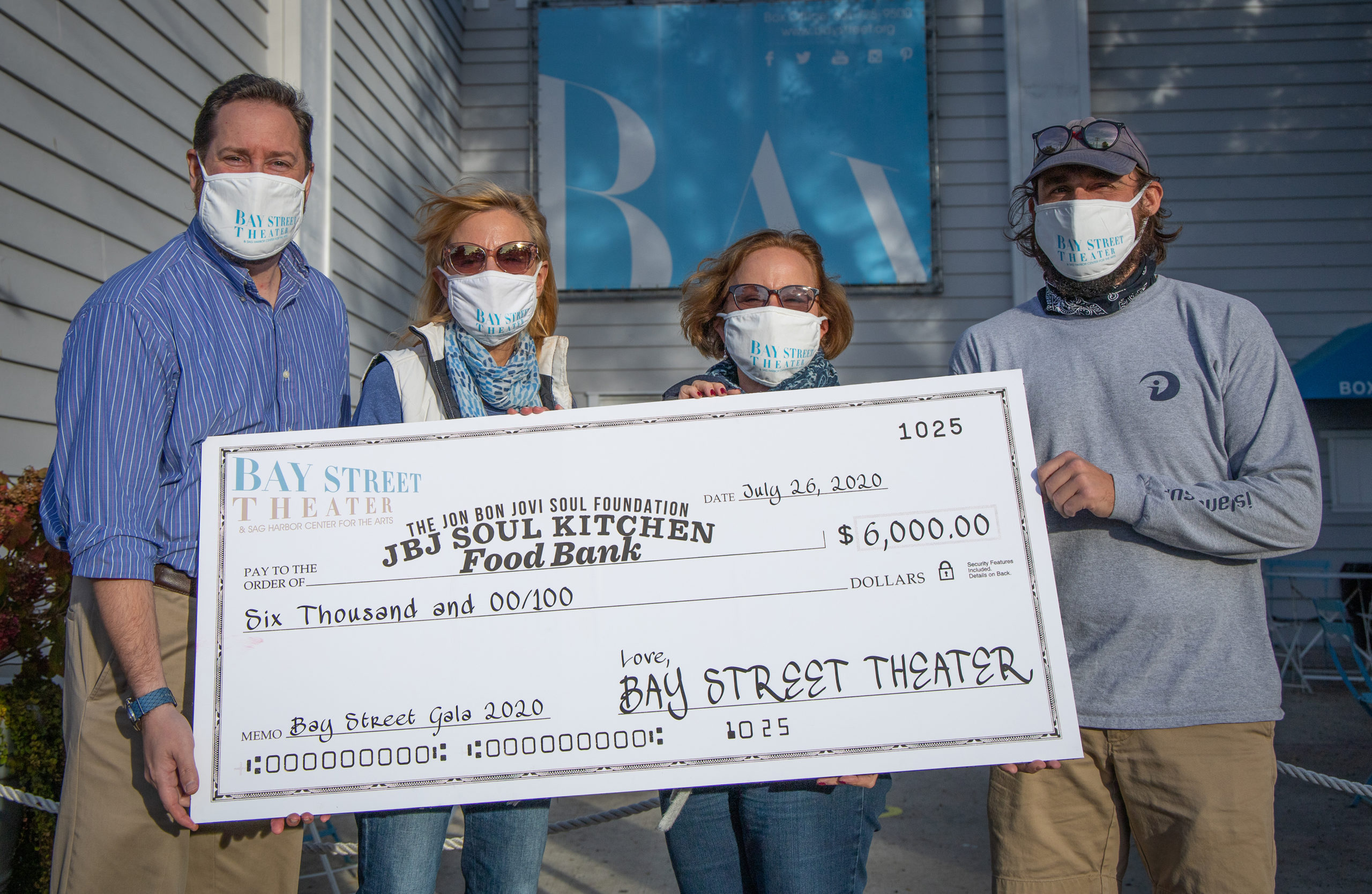 Bay Street Theater Box Office Manager David Kolodny, Executive Director Tracy Mitchell, Director of Development Kim Fink and Marketing Coordinator Michael Pintauro with a check for JBJ Soul Kitchen Food Bank.