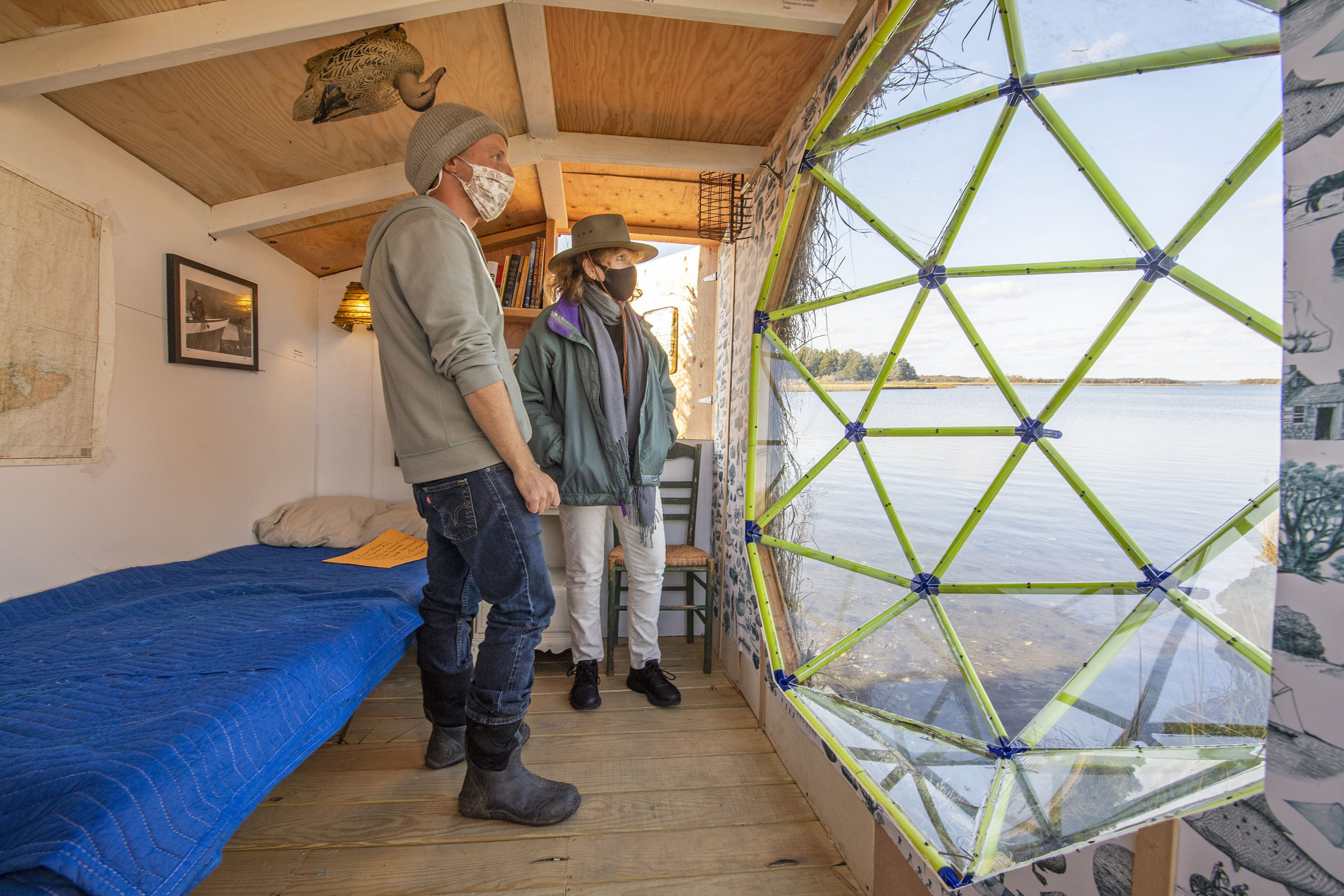 Artist Scott Bluedorn and visitor Jacqueline Marks check out the view from inside his