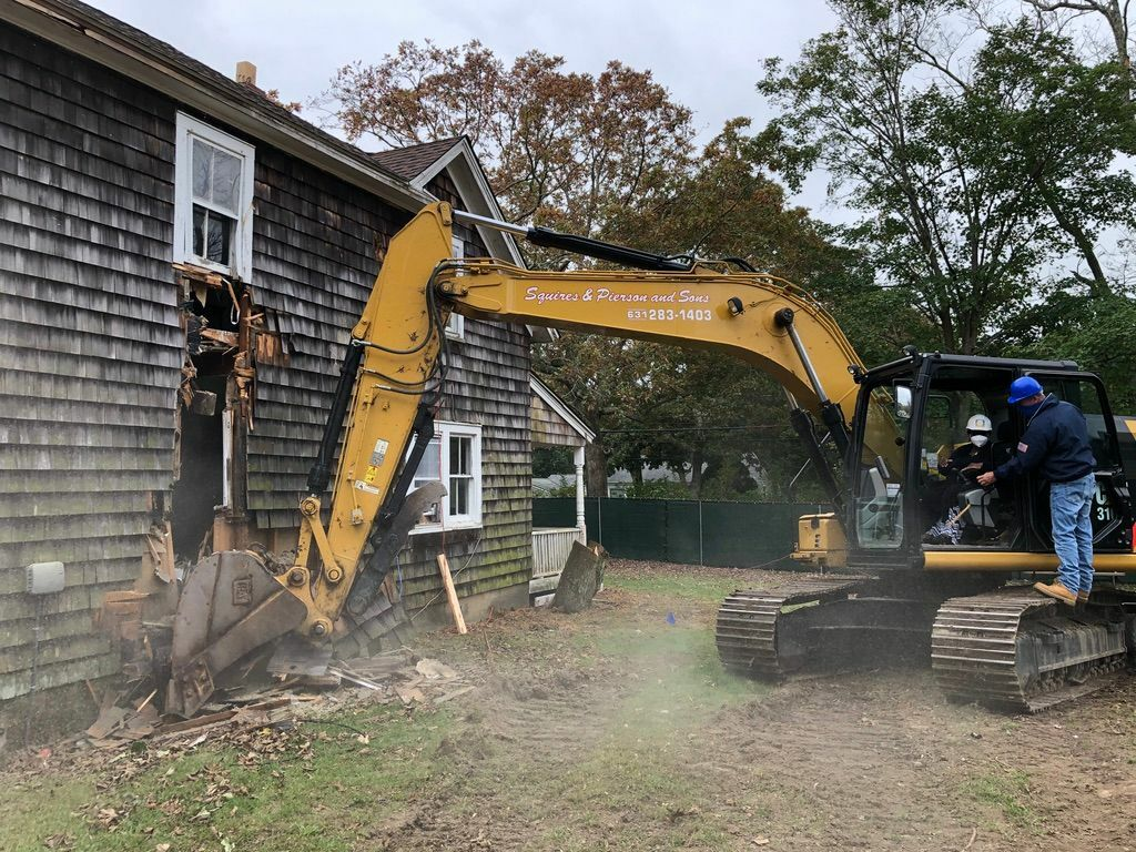 Bonnie Cannon begins the demolition of the existing buidling.