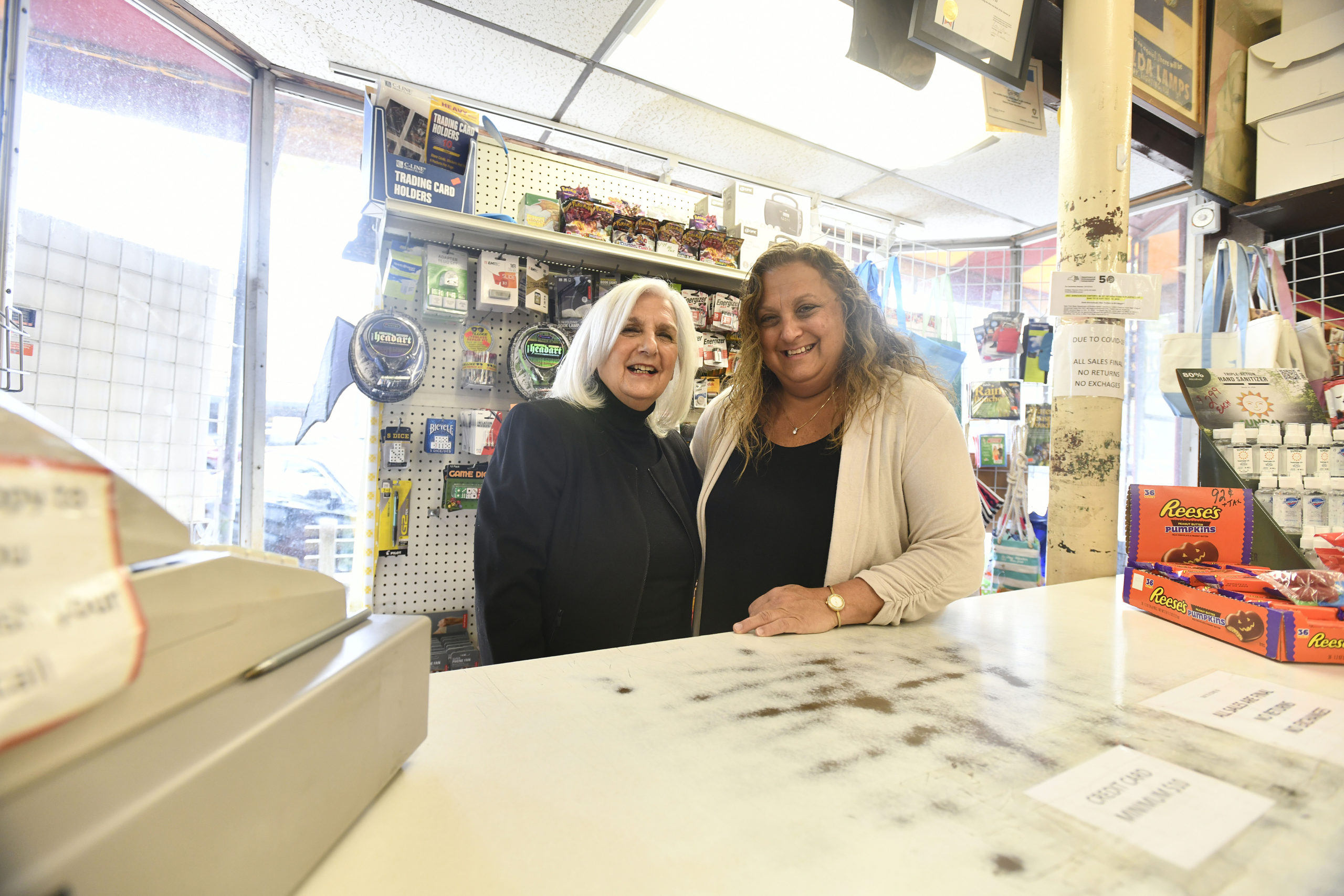 Roseann Bucking and Lisa Field behind the counter at the Sag Harbor Vaiety Store.    DANA SHAW