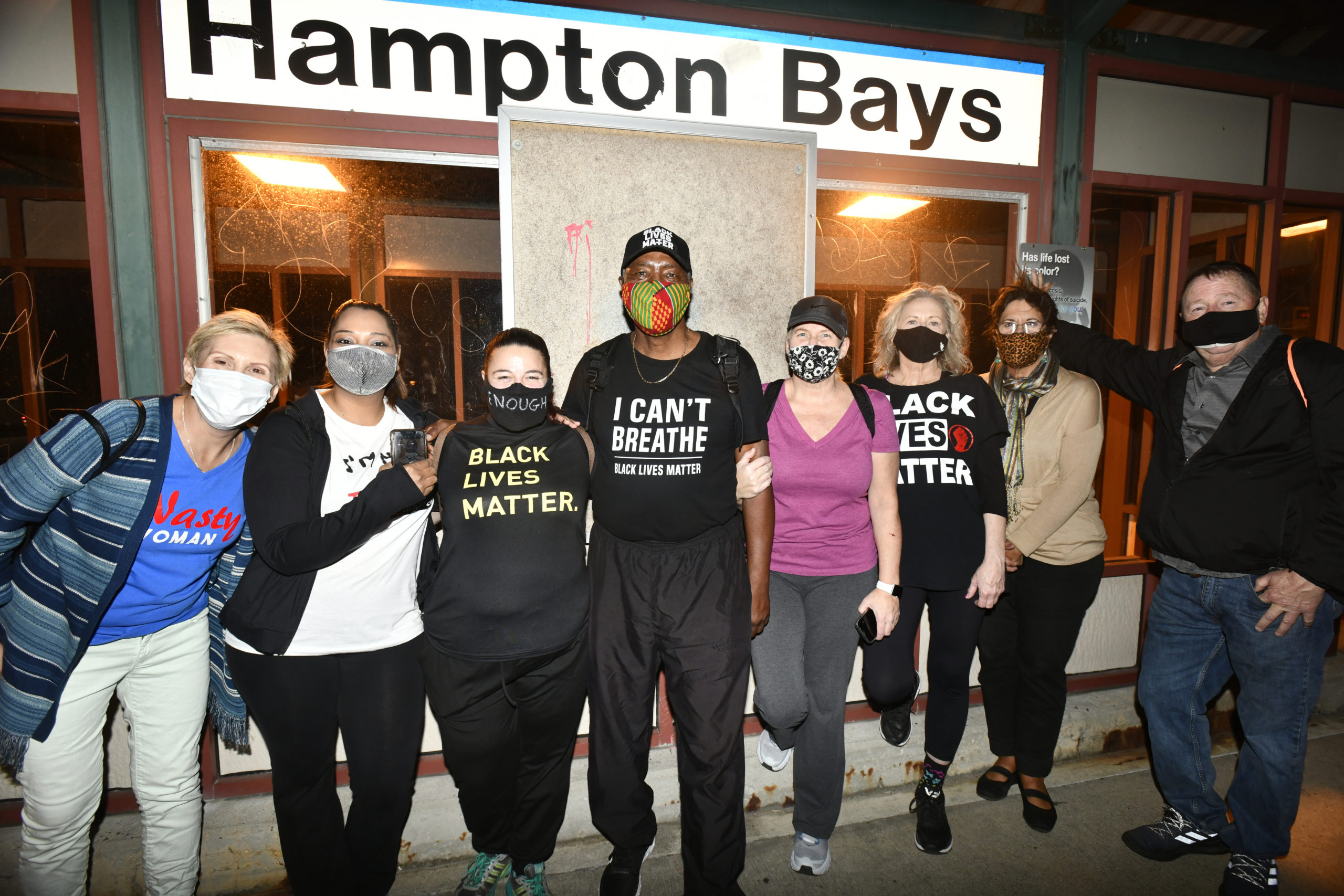 Leon Goodman and the group who walked with him on Sunday at the Hampton Bays train station.  DANA SHAW
