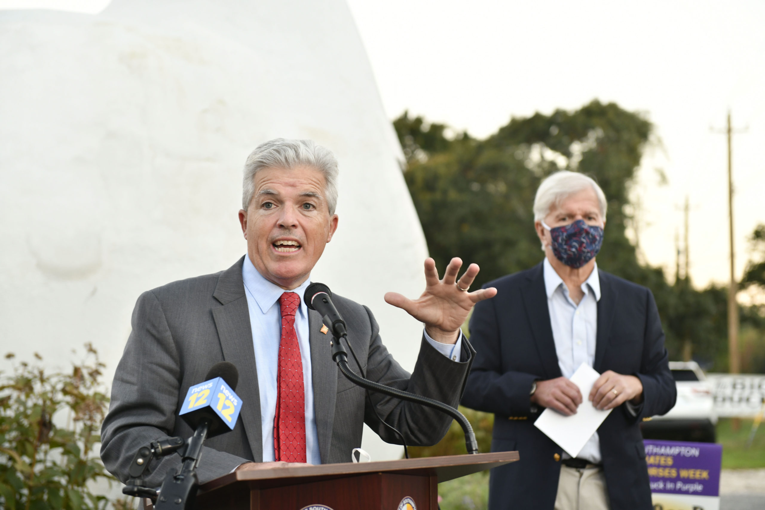 Suffolk County Executive Steve Bellone speaks at the lighting of the Big Duck on October 14, in honor of Emergency Nurses Week.   DANA SHAW