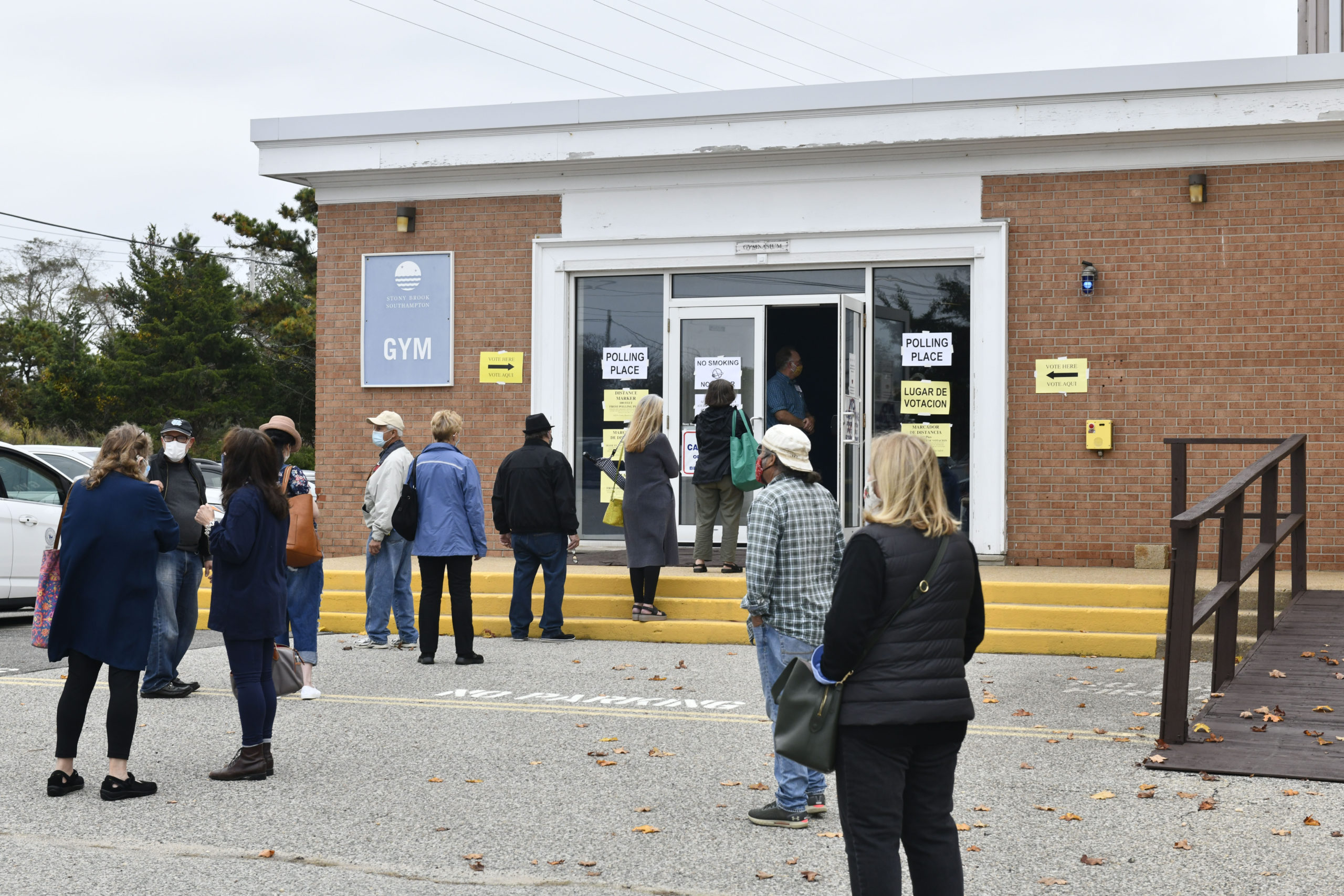 A line from the Stony Brook Southampton gym snaked on to Tuckahoe Road as early voting opened in Southamtpon Town on Saturday morning.  DANA SHAW