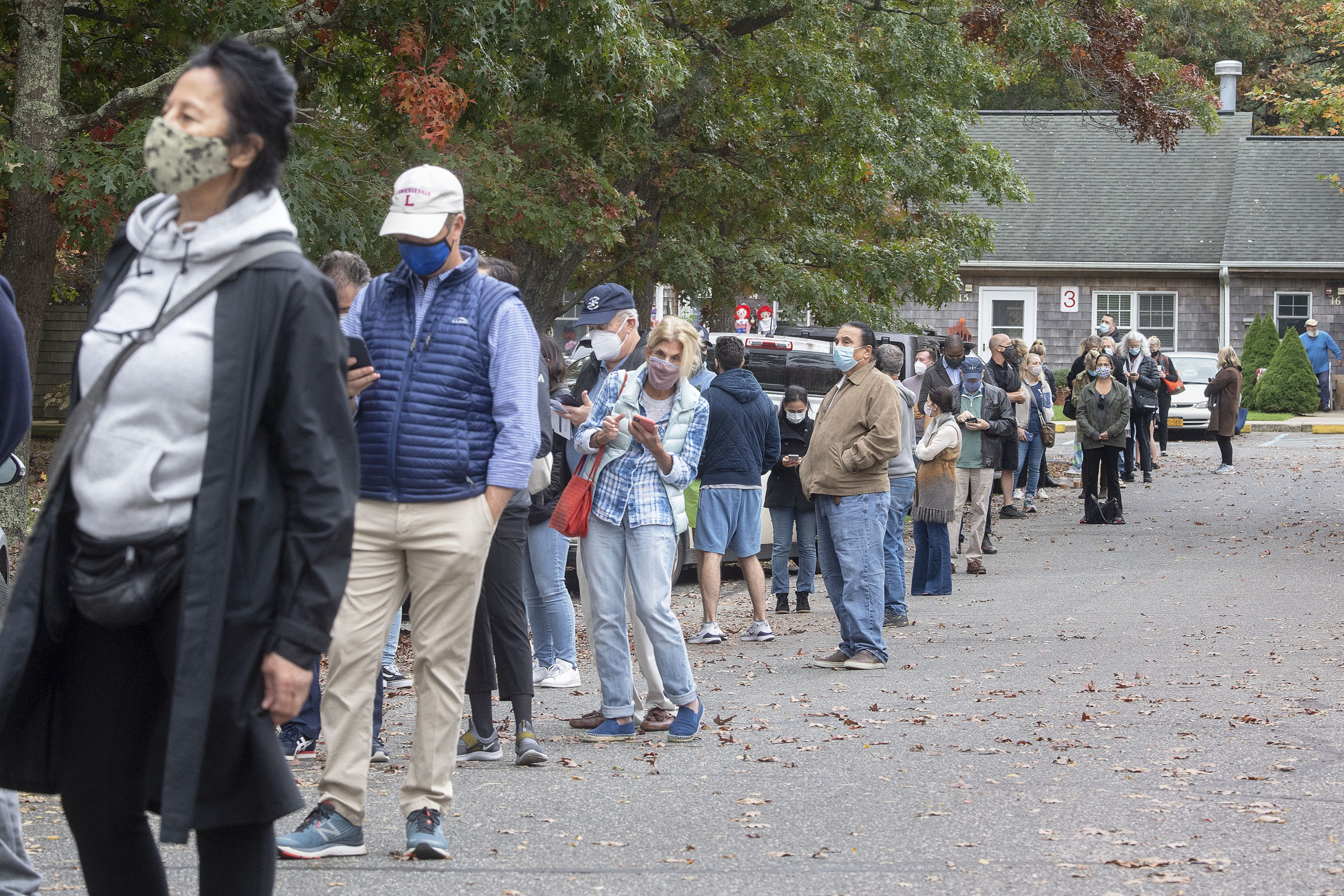 Approximately one-quarter of the first-arriving voters waiting in in line for the polling center to open during early voting at the Windmill Village complex on Accabonac Road in East Hampton on Saturday morning.  MICHAEL HELLER