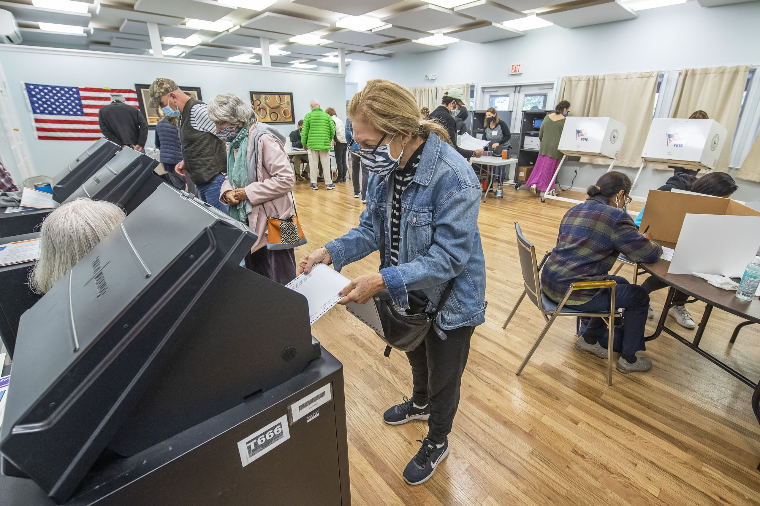 Voters cast their ballots as part of Early Voting in East Hampton Town at the Windmill Village complex on Accabonac Road on Monday morning.   MICHAEL HELLER
