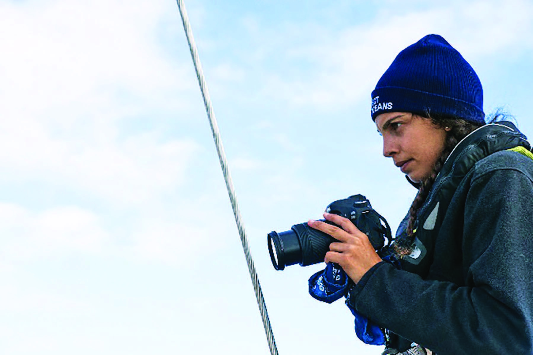 Erica Cirino documenting plastic pollution in the Atlantic Ocean while sailing with eXXpedition.
