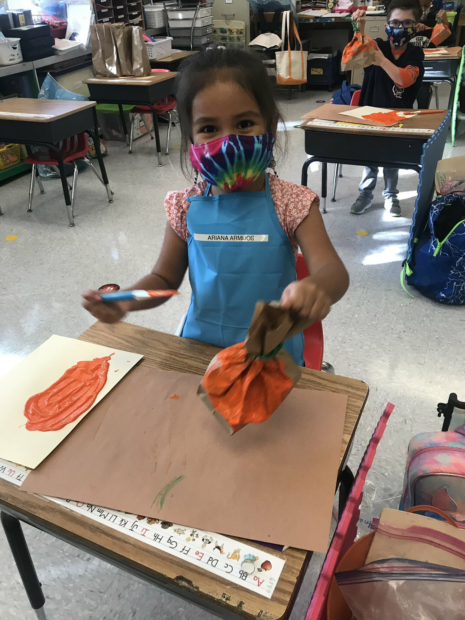 Hampton Bays Elementary School kindergartners enjoyed painting their very own pumpkins as part of a lesson.