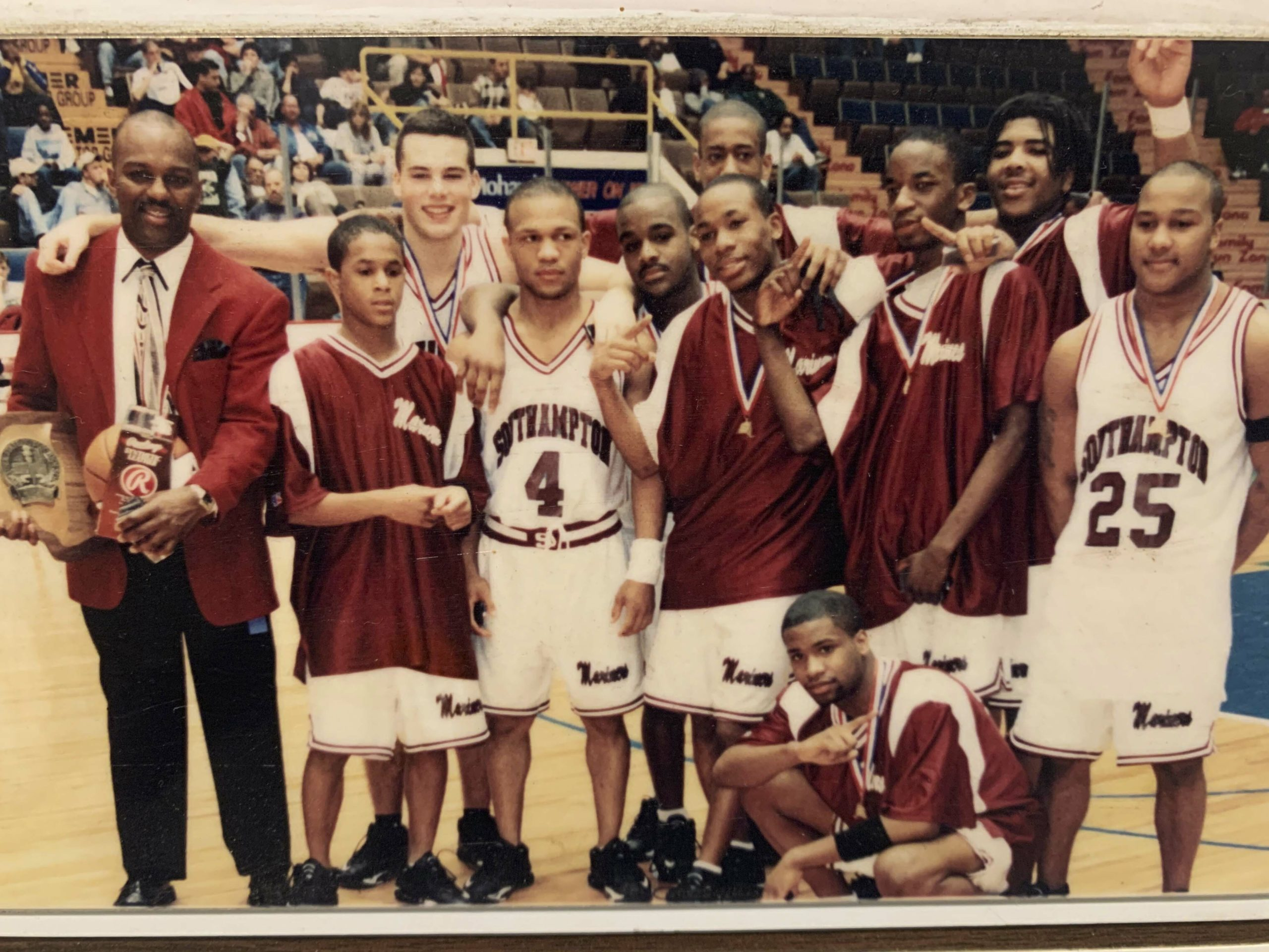 Courtney Pritchard, fifth from left, with his Southampton teammates and head coach Herm Lamison (far left) after winning the New York State Class B Championship in 2000.